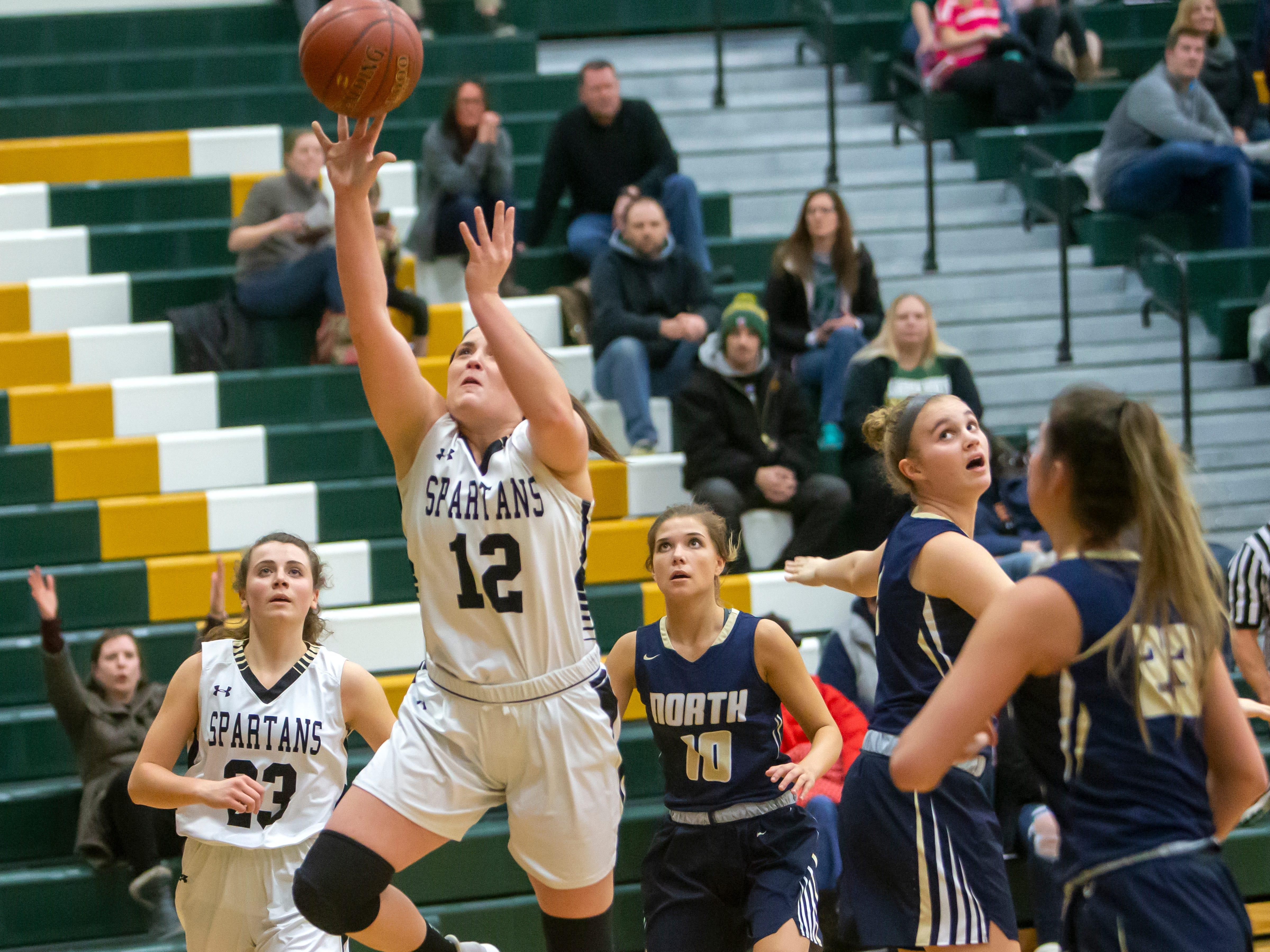 Oshkosh North's Brie Gauthier goes up for a shot at a girls basketball game against Appleton North Friday, February 8, 2019, in Oshkosh, Wis., at Oshkosh North High School.