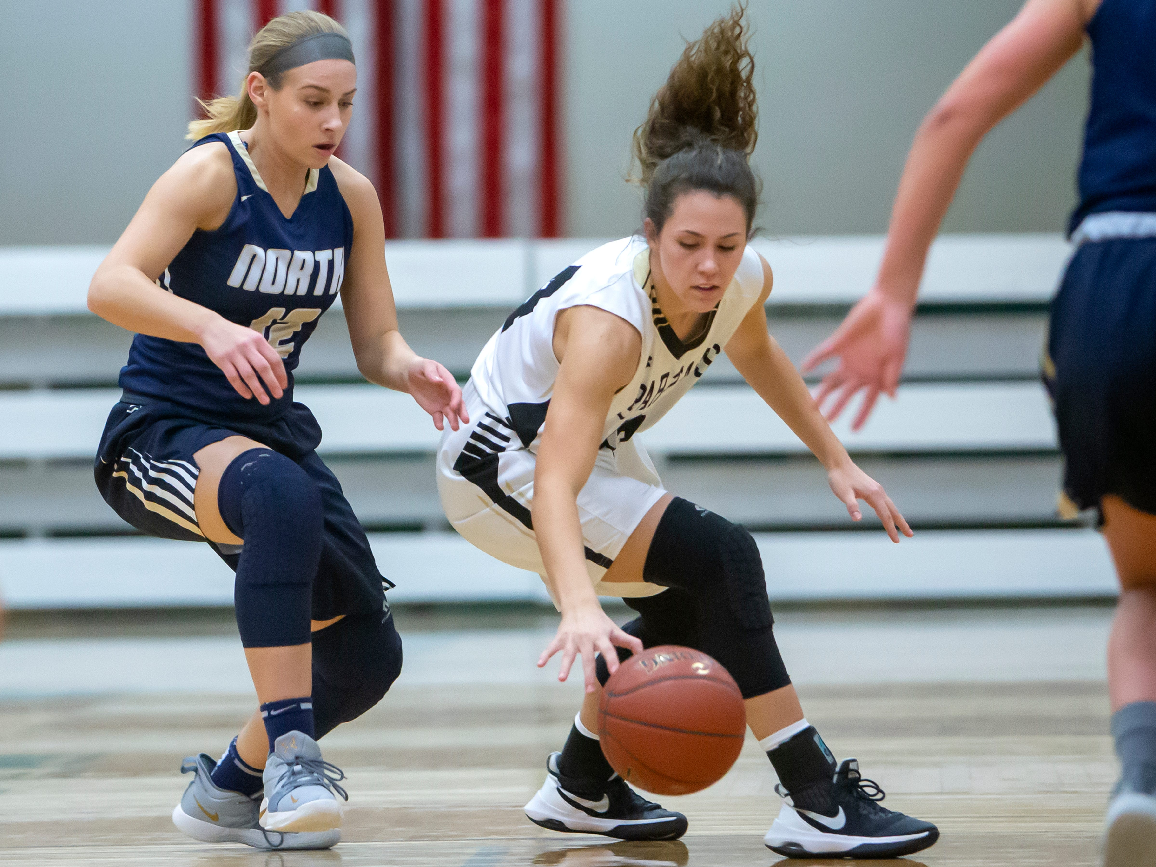 Ilana Milos gains control of a loose ball during a girls basketball Friday game against Appleton North, February 8, 2019, in Oshkosh, Wis., at Oshkosh North High School.