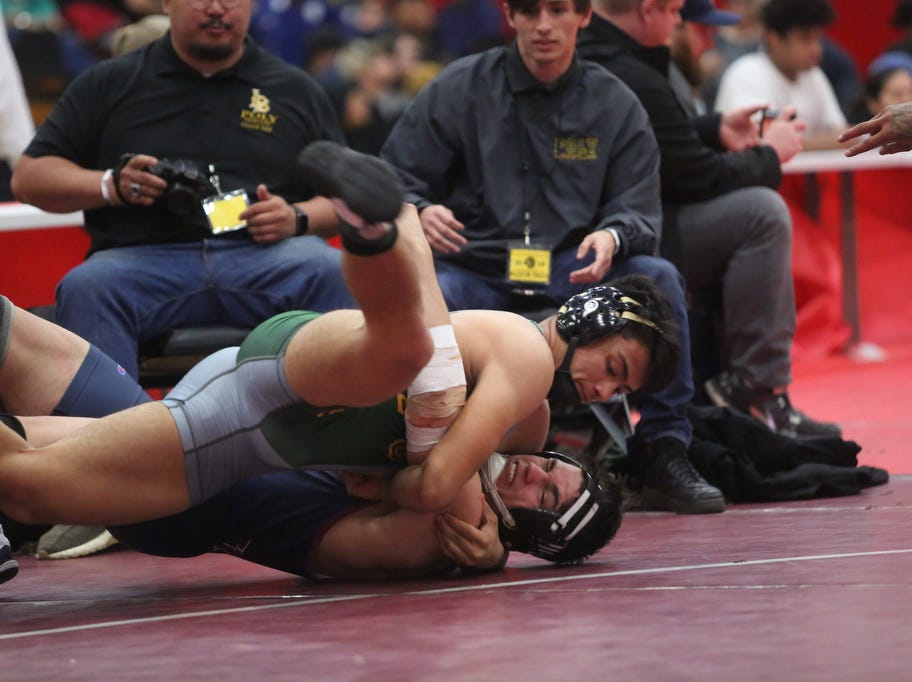 At top, La Quinta High School's Aidan Miller, in black cap, wrestles with Alex Godina of Westminster during their semifinal match at Palm Springs, High School on February 9, 2019.