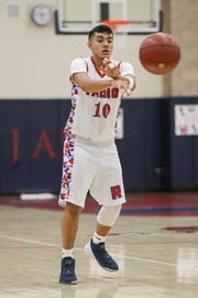 Indio's Jose Briceno passes the ball Friday night against Dana Hills during the Rajahs' 53-32 loss in a first-round Division 4AA playoff game.