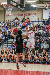 Indio's Isaiah Riley, right, goes up for the layup during the Rajahs' 53-32 loss in a first-round Division 4AA playoff game.
