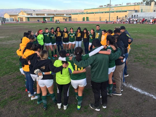 The Coachella Valley girls' soccer team huddles up after winning their second-round CIF-SS playoff game against Wilson (Hacienda Heights) 1-0