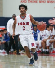 Indio's Isaiah Riley dribbles the ball during the Rajahs' 53-32 loss in a first-round Division 4AA playoff game.