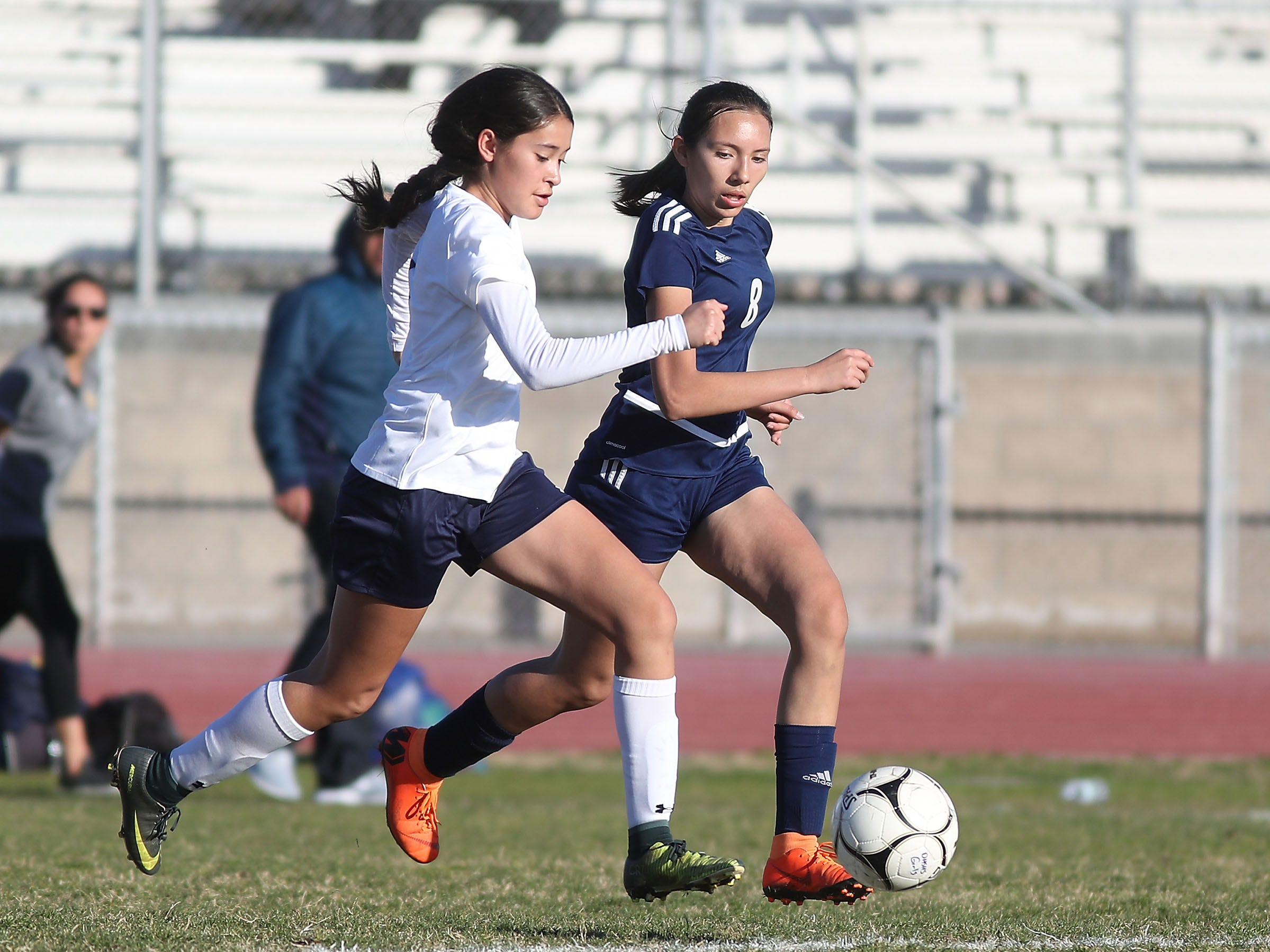 Citlaly Fuentes, right, of Desert Hot Springs runs down Santa Clara on defense during their match, February 8, 2019.