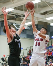 Indio's Jose Briceno takes a jump shot during the second quarter of the Rajahs' 53-32 loss in a first-round Division 4AA playoff game.