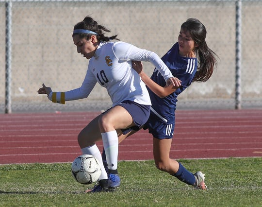 Metzli Aguilar, right, of Desert Hot Springs fights for possession of the ball against Santa Clara during their match, February 8, 2019.