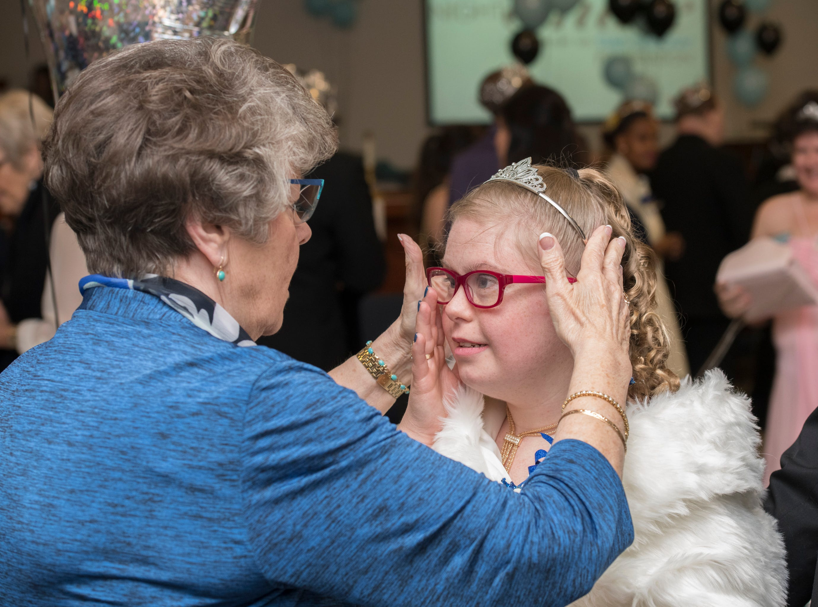 Kaitlyn Evans has her tiara adjusted at the beginning of the Night to Shine prom for people with special needs sponsored by the Tim Tebow Foundation at Perdido Bay United Methodist Church in Pensacola on Friday, February 8, 2019.