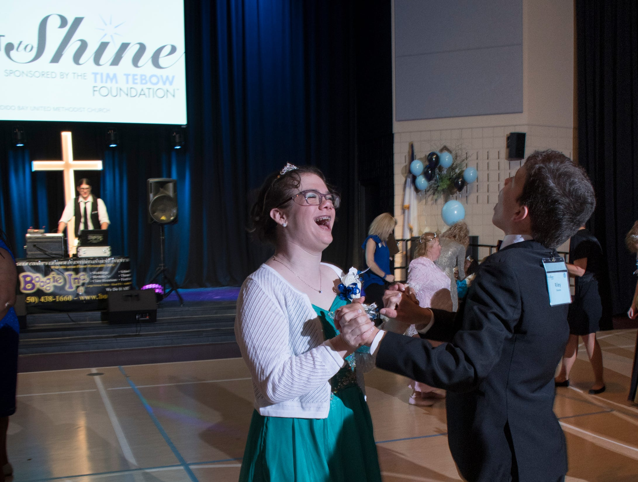 Haylee Andrews is all smiles as she dances with Riley Stevens during the Night to Shine prom for people with special needs sponsored by the Tim Tebow Foundation at Perdido Bay United Methodist Church in Pensacola on Friday, February 8, 2019.