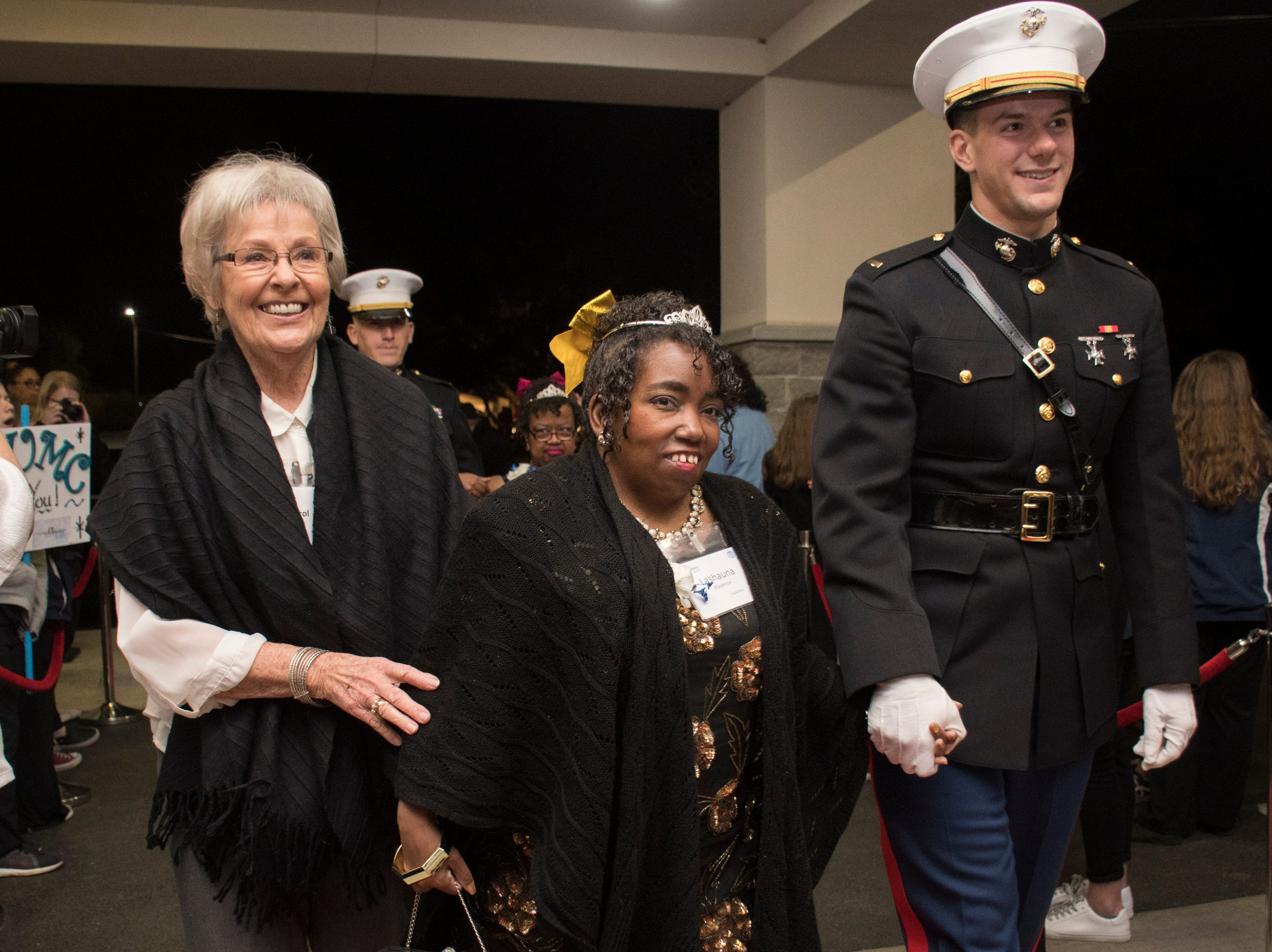 Lashauna Backmon is escorted into the Night to Shine prom for people with special needs sponsored by the Tim Tebow Foundation at Perdido Bay United Methodist Church in Pensacola on Friday, February 8, 2019.