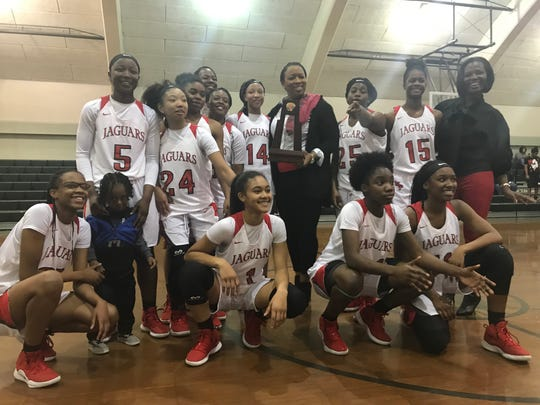 The West Florida girls basketball team celebrates its District 1-5A championship at Pensacola Catholic on Feb. 8, 2019.