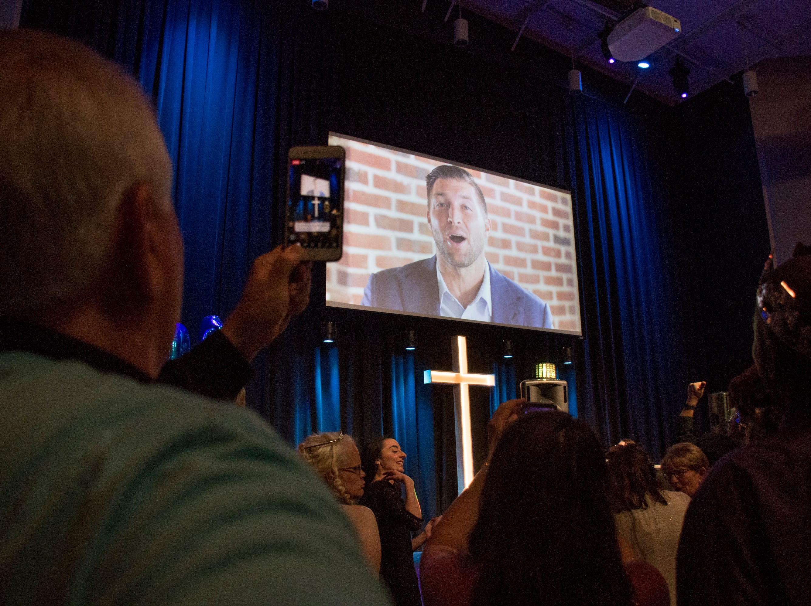 Tim Tebow talks to guests during a video presentation at the Night to Shine prom for people with special needs sponsored by the Tim Tebow Foundation at Perdido Bay United Methodist Church in Pensacola on Friday, February 8, 2019.
