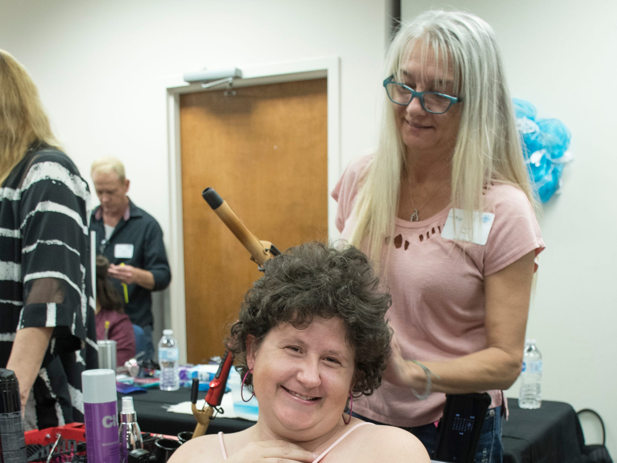 Kelly Swier has her hair styled at the beginning of the Night to Shine prom for people with special needs sponsored by the Tim Tebow Foundation at Perdido Bay United Methodist Church in Pensacola on Friday, February 8, 2019.
