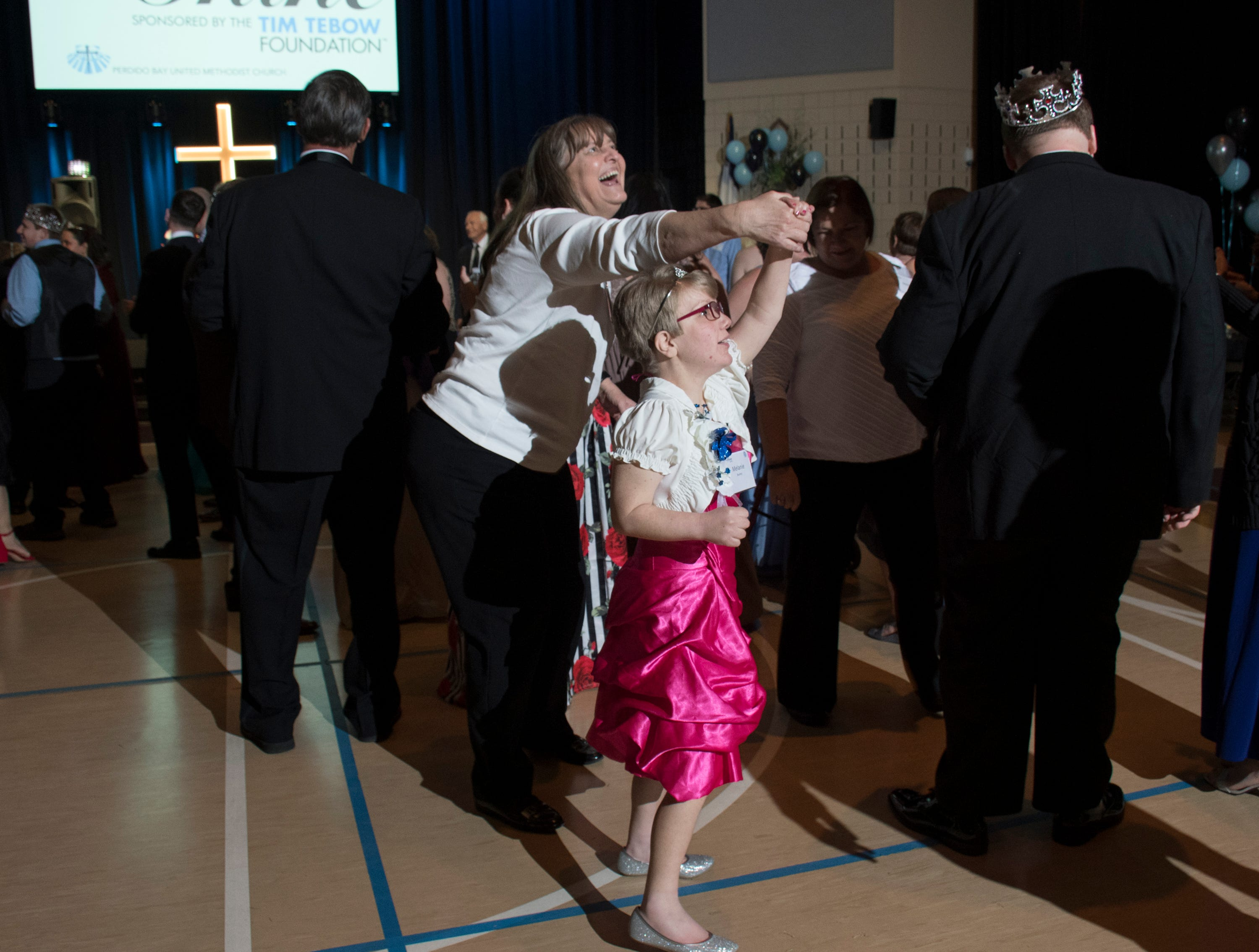 Melanie Bushey dances with her buddy Diane during the Night to Shine prom for people with special needs sponsored by the Tim Tebow Foundation at Perdido Bay United Methodist Church in Pensacola on Friday, February 8, 2019.