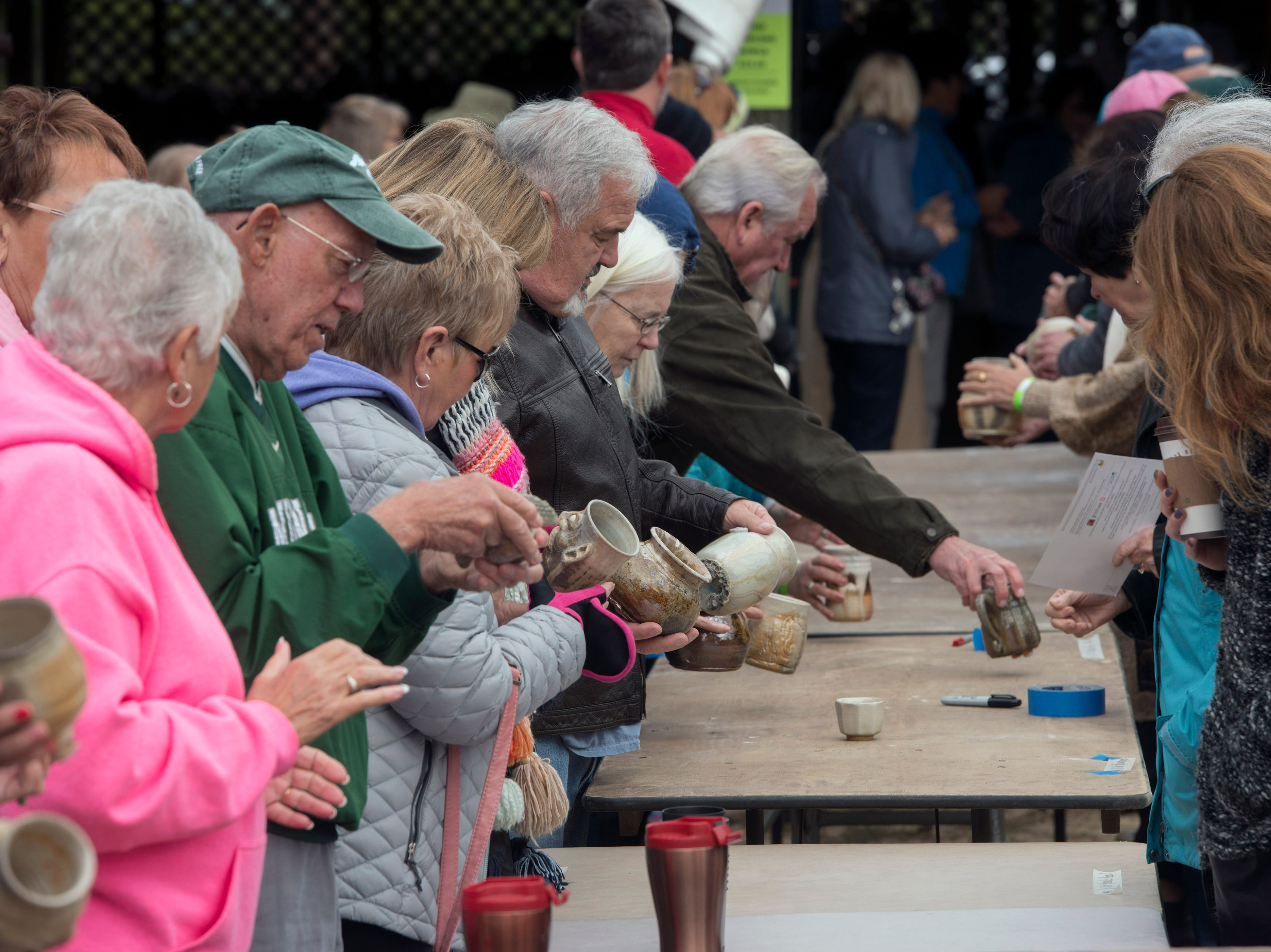 The public checks out pottery fresh from the kiln Saturday, February 9, 2019, during the 14th annual Woodstoke Pottery and Kiln Festival at Holly Hill Pottery in Navarre.