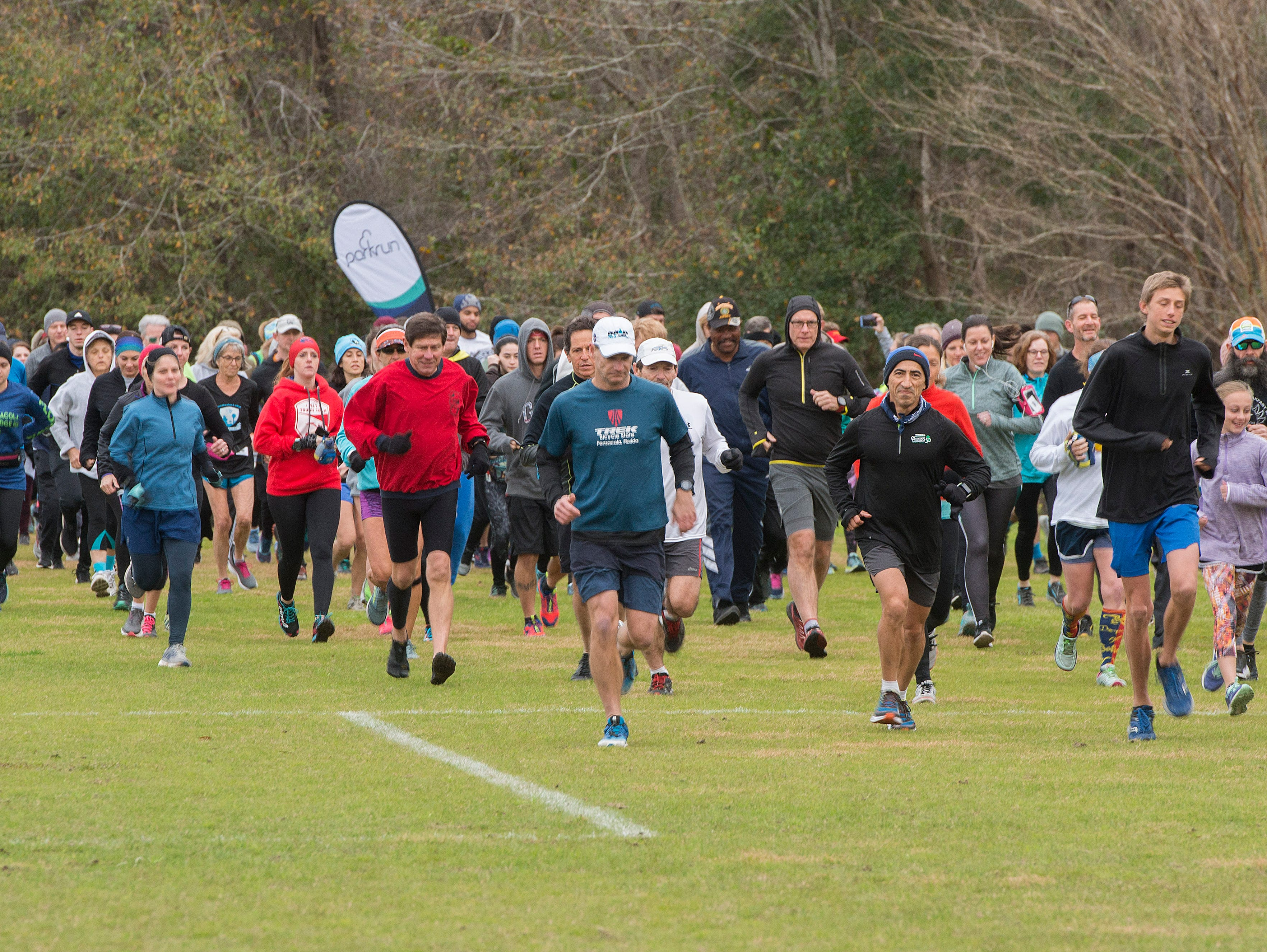 Runners make their way along the course Saturday, February 9, 2019 during the Parkrun 5k at the University of West Florida.