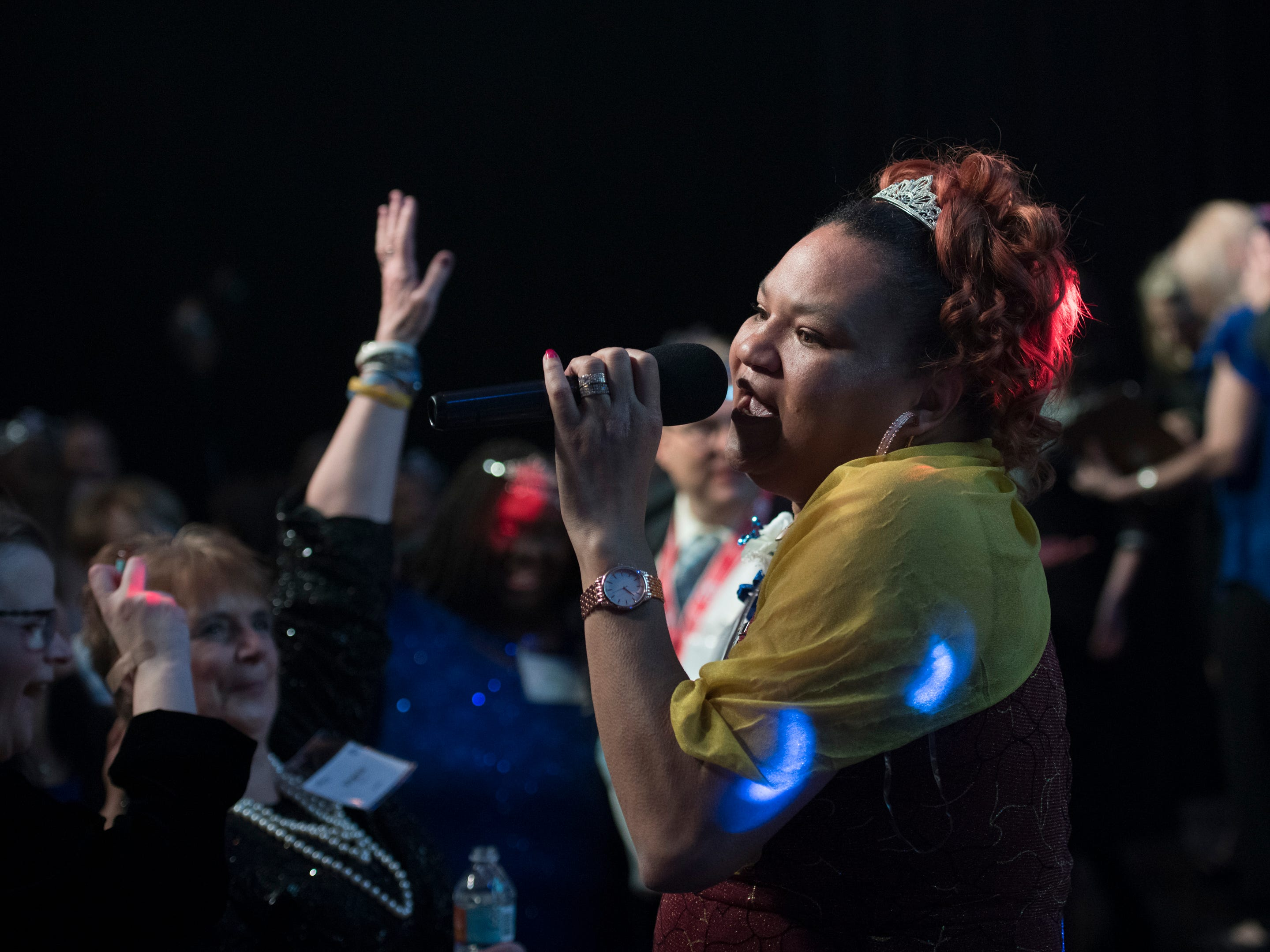 Bridgett Smith sings during the Night to Shine prom for people with special needs sponsored by the Tim Tebow Foundation at Perdido Bay United Methodist Church in Pensacola on Friday, February 8, 2019.