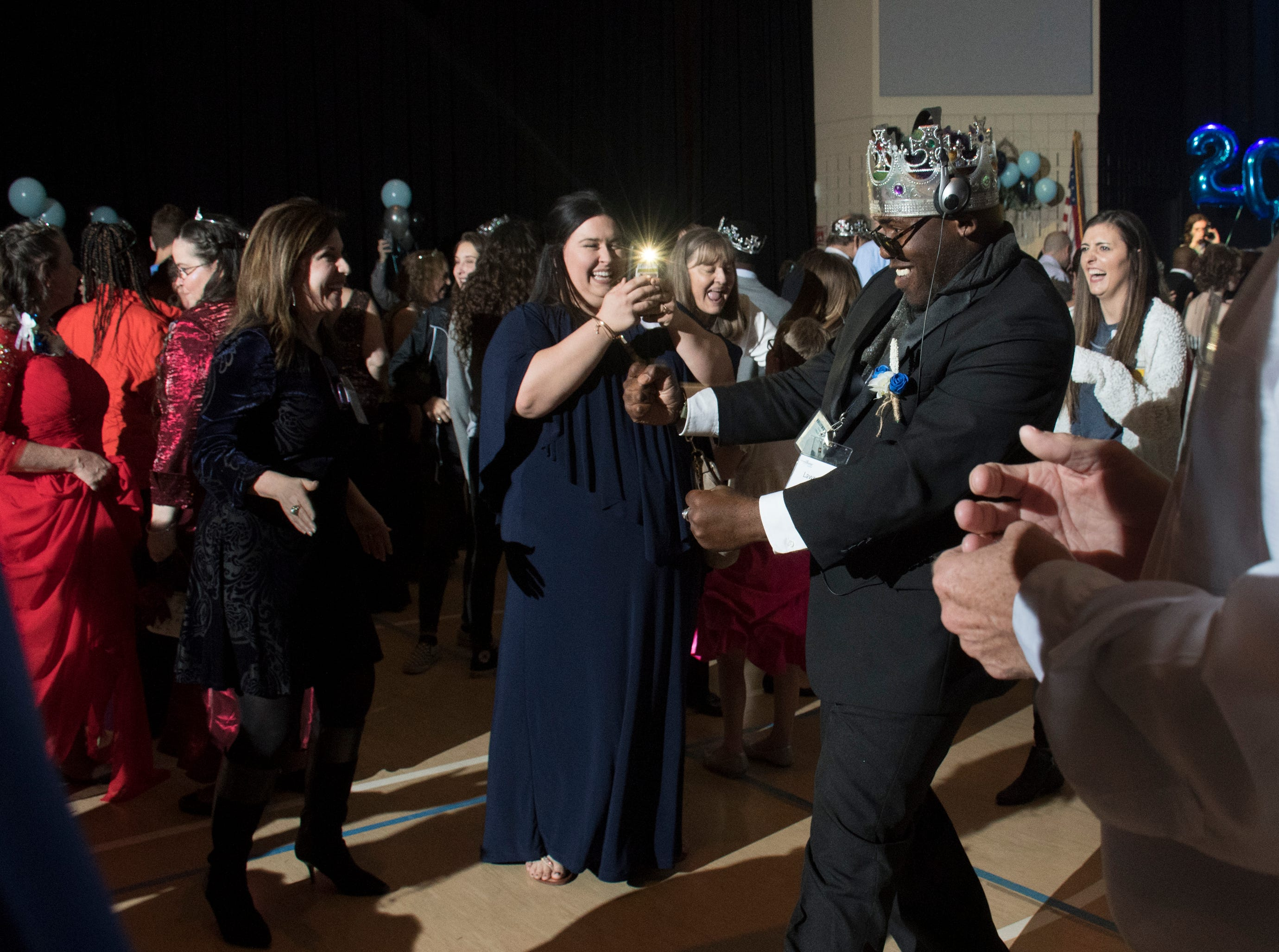 Lawrence Jones, right, shows his dance moves during the Night to Shine prom for people with special needs sponsored by the Tim Tebow Foundation at Perdido Bay United Methodist Church in Pensacola on Friday, February 8, 2019.