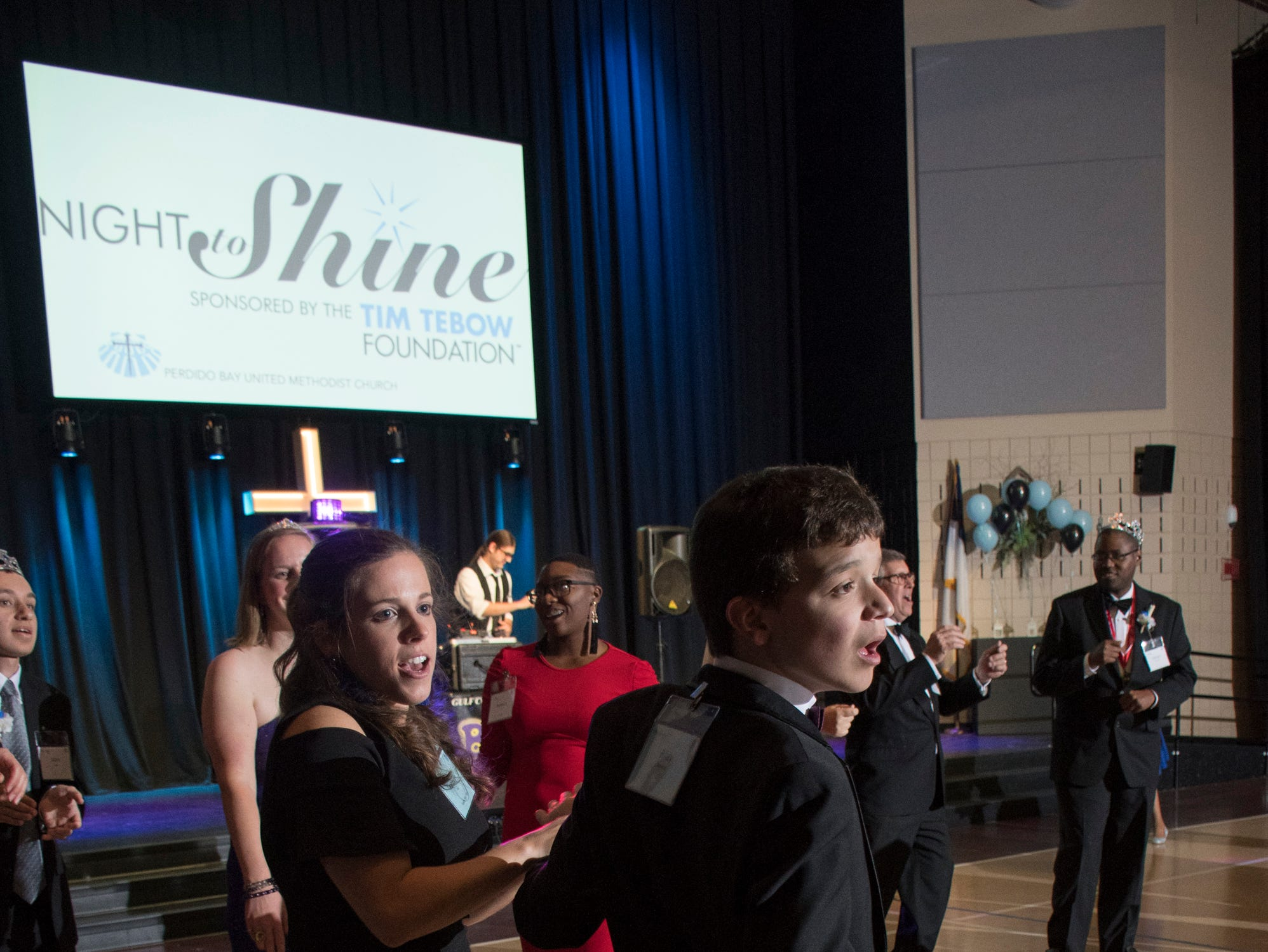 Kathleen Ross dances with Riley Stevens during the Night to Shine prom for people with special needs sponsored by the Tim Tebow Foundation at Perdido Bay United Methodist Church in Pensacola on Friday, February 8, 2019.