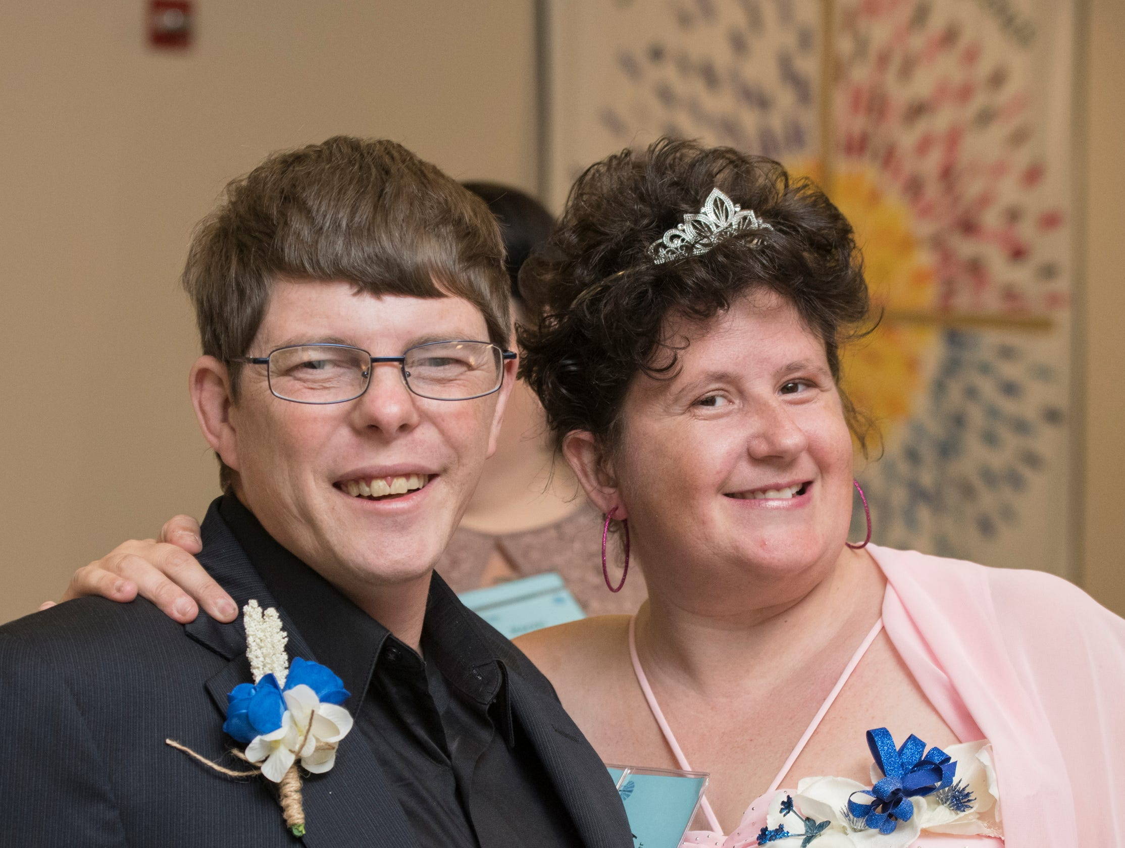 Erick Turner and Kelly Swier pose for a photo at the beginning of the Night to Shine prom for people with special needs sponsored by the Tim Tebow Foundation at Perdido Bay United Methodist Church in Pensacola on Friday, February 8, 2019.