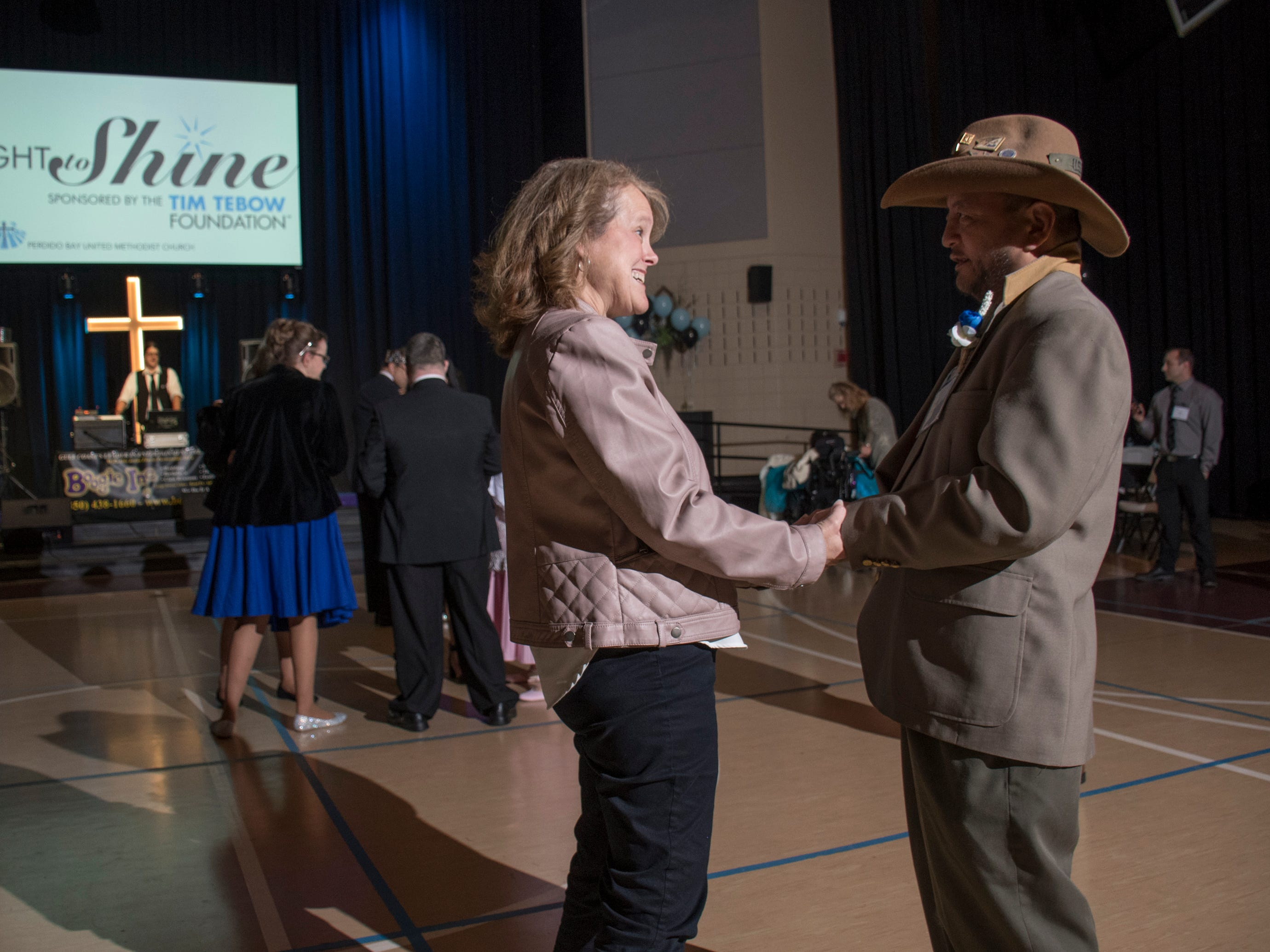 Sherri dances with Jody Fejeran during the Night to Shine prom for people with special needs sponsored by the Tim Tebow Foundation at Perdido Bay United Methodist Church in Pensacola on Friday, February 8, 2019.