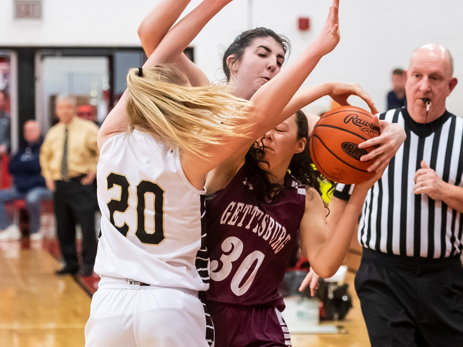 "Gettysburg's Cheyenne Proctor (30) gets trapped between Delone Catholic's Brooke Lawyer (20) and Bradi Zumbrum during play in a YAIAA quarterfinal game at Dover High School Friday, February 8, 2019. ""We knew that they're a good team,"" Cheyenne Proctor said. ""We're a good team. It just came down to who played defense and who had the most energy."""