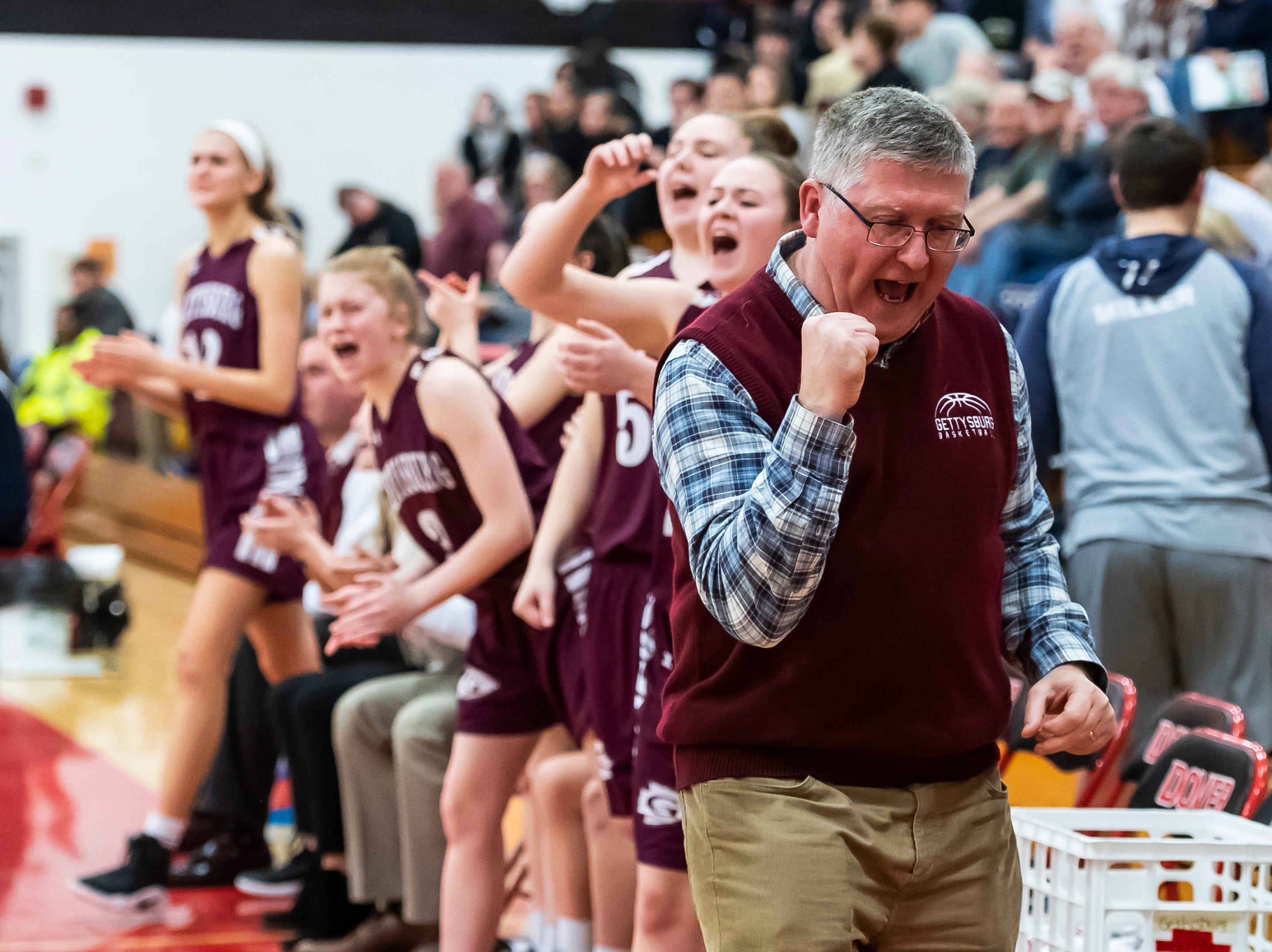"Gettysburg coach Jeff Bair reacts after the Warriors score a basket during play against Delone Catholic in a YAIAA quarterfinal game at Dover High School Friday, February 8, 2019. ""The ball bounced well for us tonight, and it didn't bounce well for them,"" Bair said after the game. ""We have good pieces that can adapt to different situations, and tonight we took what they gave us, and we were successful."""