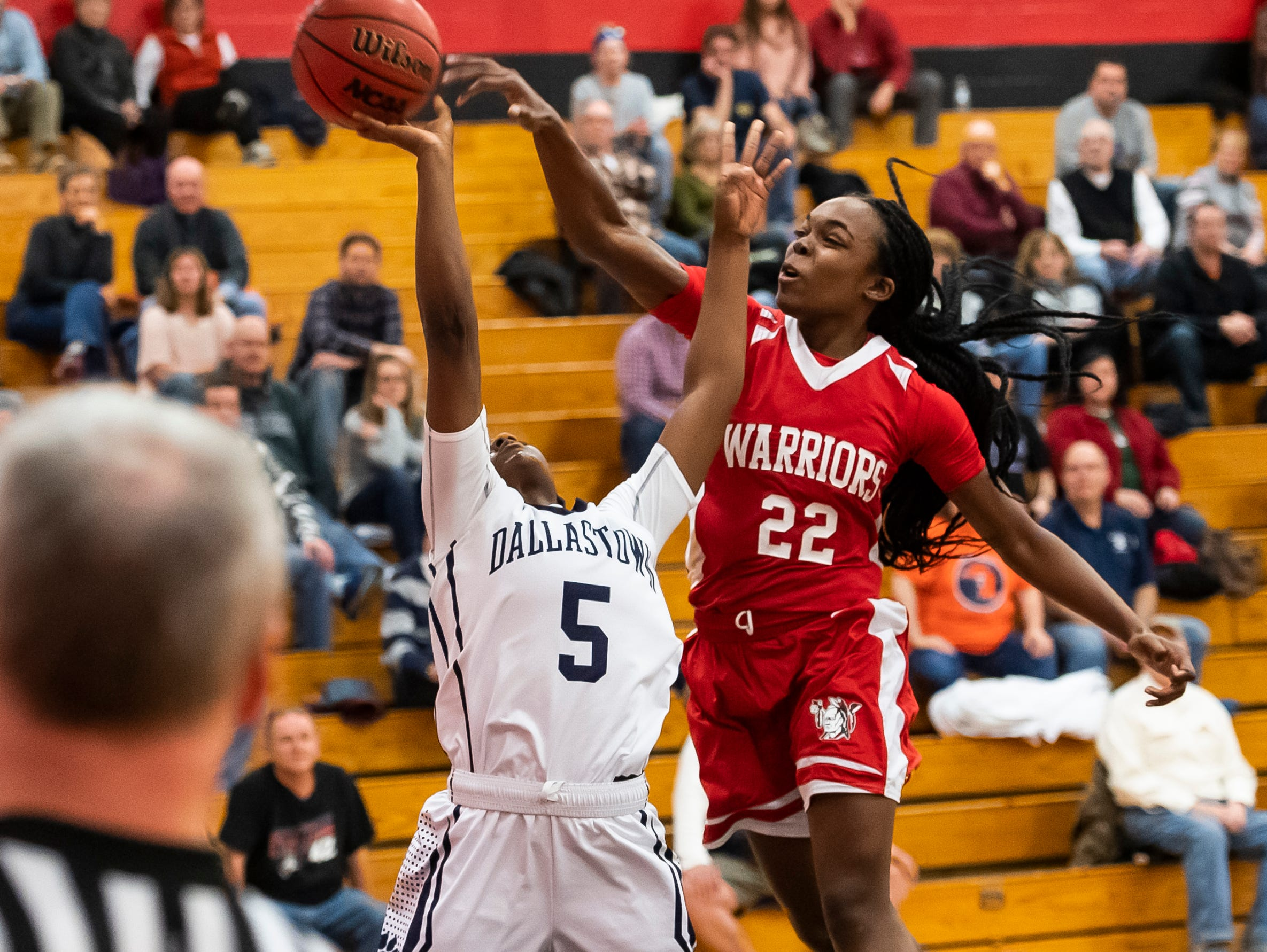 Susquehannock's Jaden Walker (22) blocks a shot from Dallastown's D'Shantae Edwards in a YAIAA quarterfinal game at Dover High School Friday, February 8, 2019. The Wildcats won 42-29.