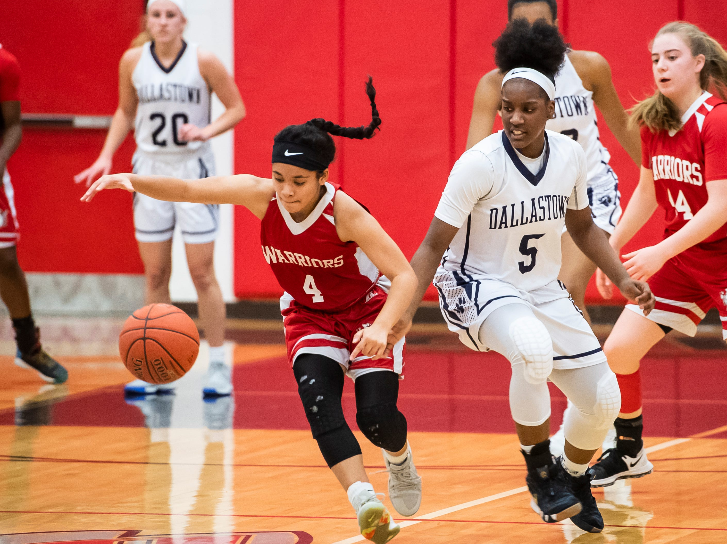 Susquehannock's Jayla Galbreath (4) and Dallastown's D'Shantae Edwards eye a loose ball during a YAIAA quarterfinal game at Dover High School Friday, February 8, 2019. The Wildcats won 42-29. Edwards, a freshman, led all scorers with 12 points.