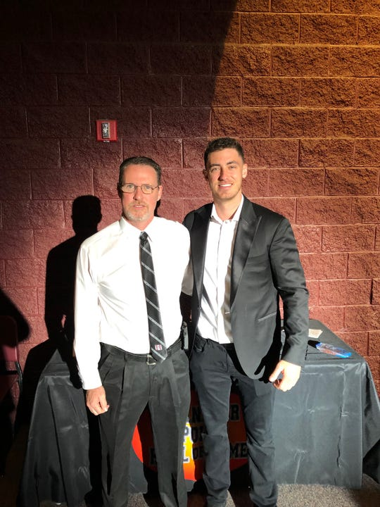 Cody Bellinger poses with long-time Hamilton athletic trainer Lance Michael at the Chandler Sports Hall of Fame induction ceremony on Saturday.