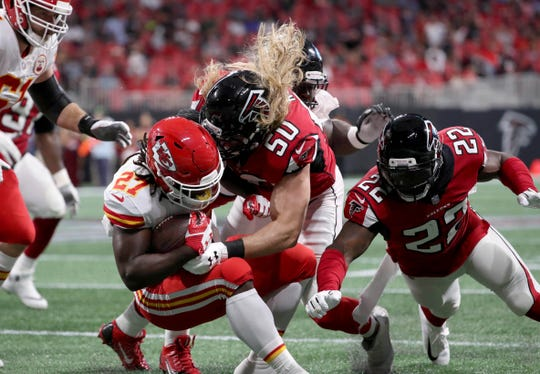 Falcons defensive end Brooks Reed tackles Chiefs running back Kareem Hunt (27) during the the first quarter of a game Aug. 17 at Mercedes-Benz Stadium.
