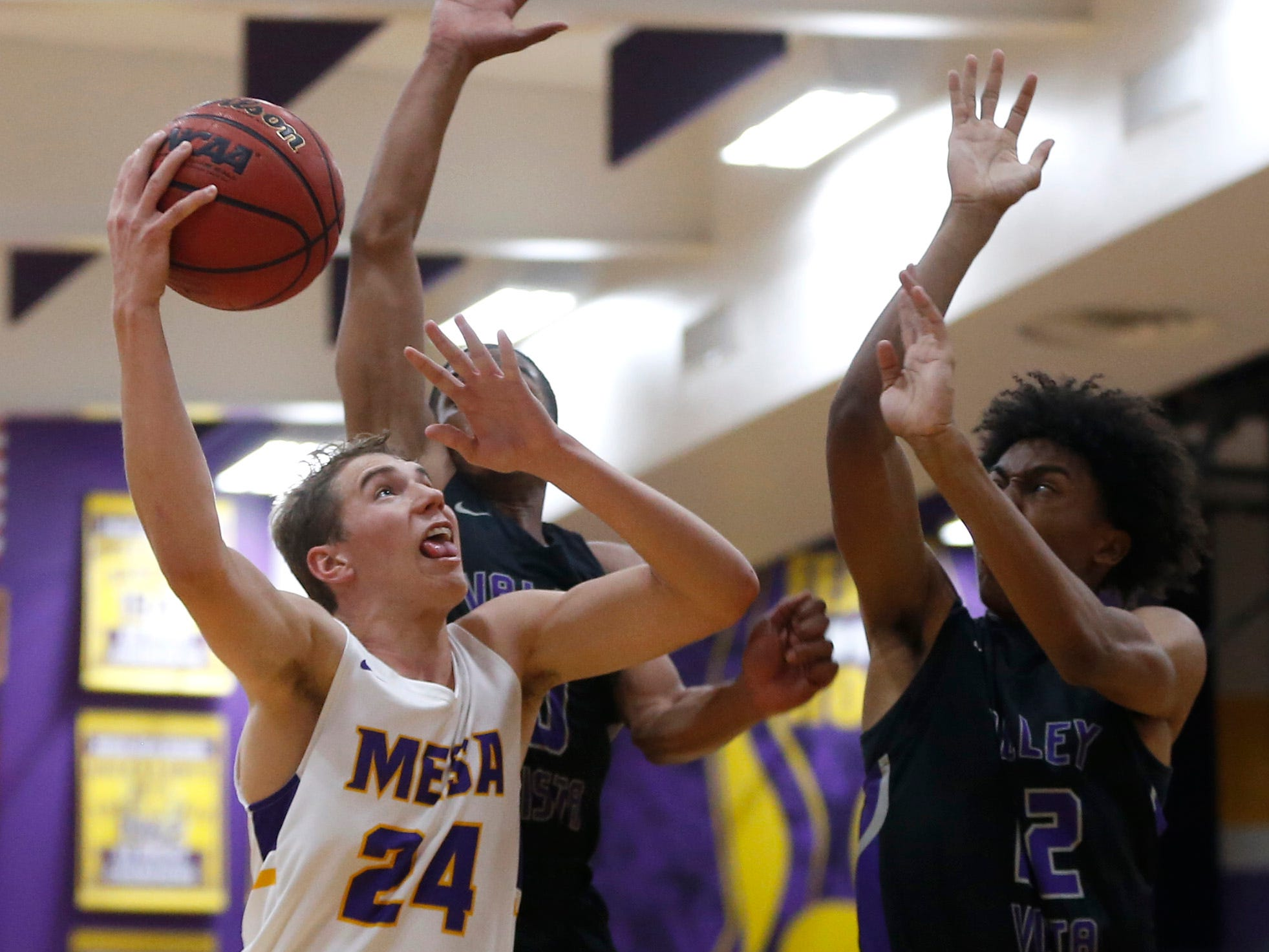 Mesa's Zach Hobbs (24) shoots against Valley Vista's Curtis Nichols (22) during the first half of the boys basketball tournament play-in game at Mesa High School in Mesa, Ariz. on February 8, 2019.