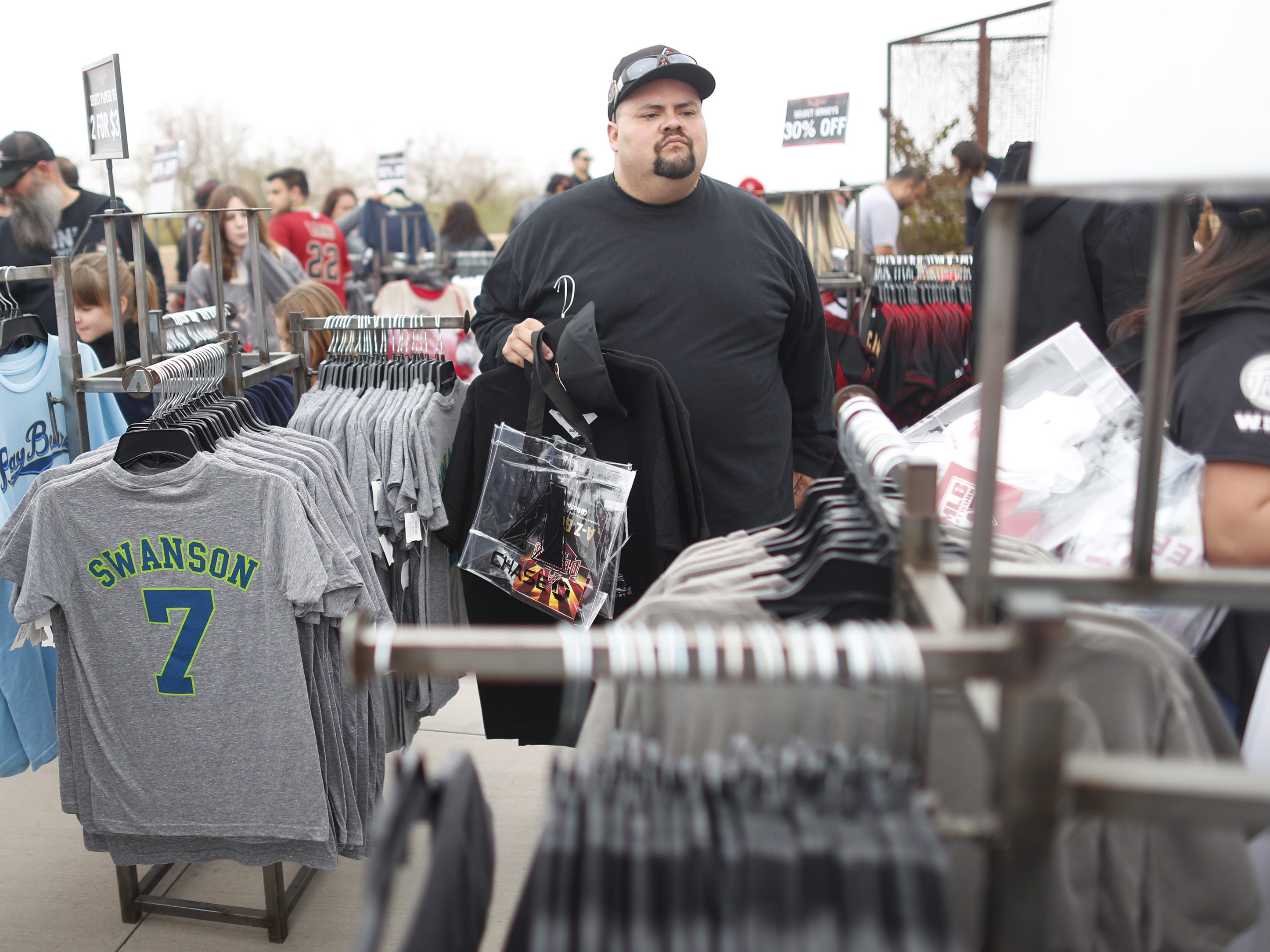 Fans look through the discount merchandise during the Diamondbacks Fan Fest at Salt River at Talking Sticks on February 9, 2019.