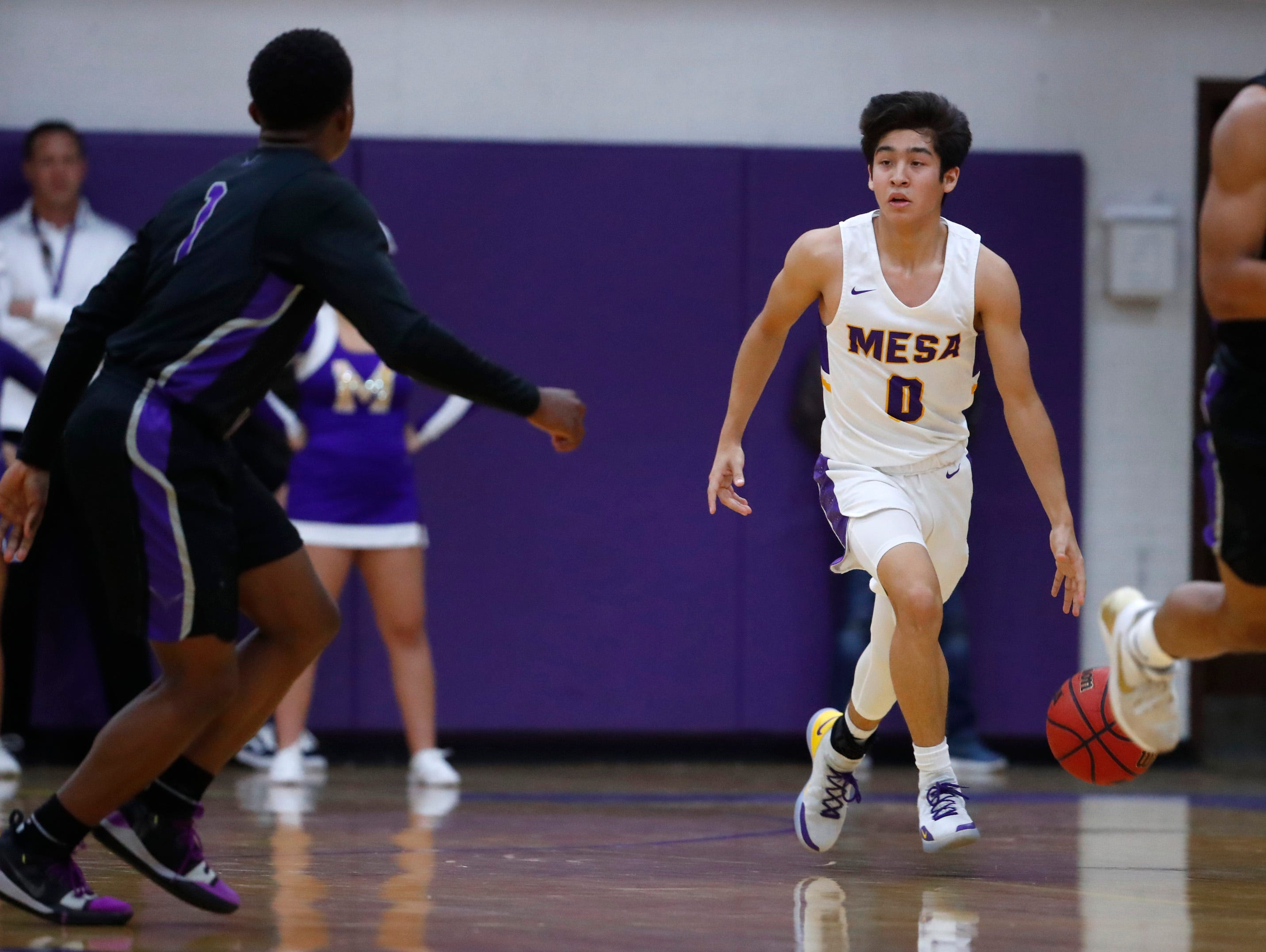 Mesa's Tony Adame (0) dribbles up court against Valley Vista during the first half of the boys basketball tournament play-in game at Mesa High School in Mesa, Ariz. on February 8, 2019.