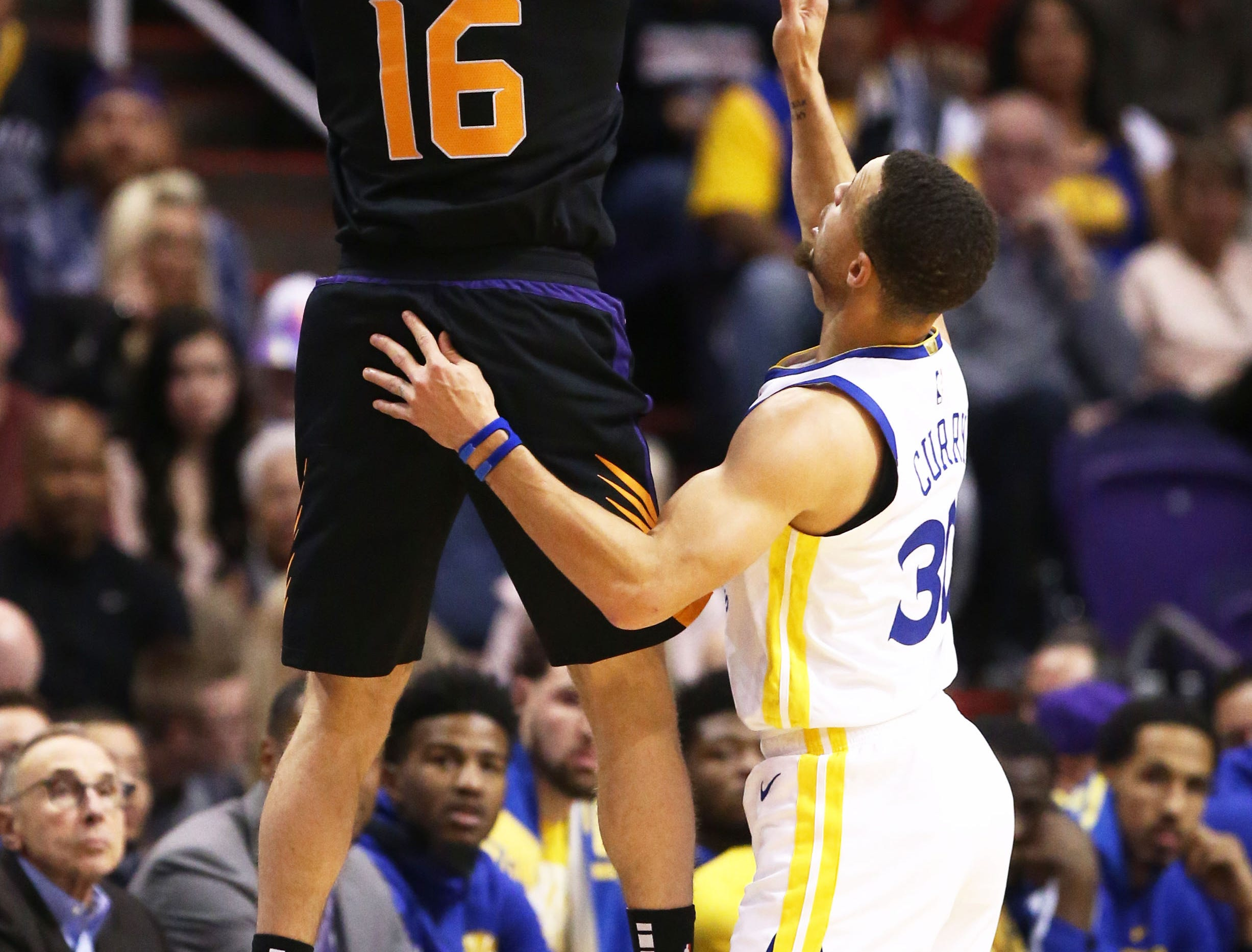Phoenix Suns guard Tyler Johnson steals thje ball from Golden State Warriors guard Stephen Curry in the first half on Feb. 8 at Talking Stick Resort Arena.