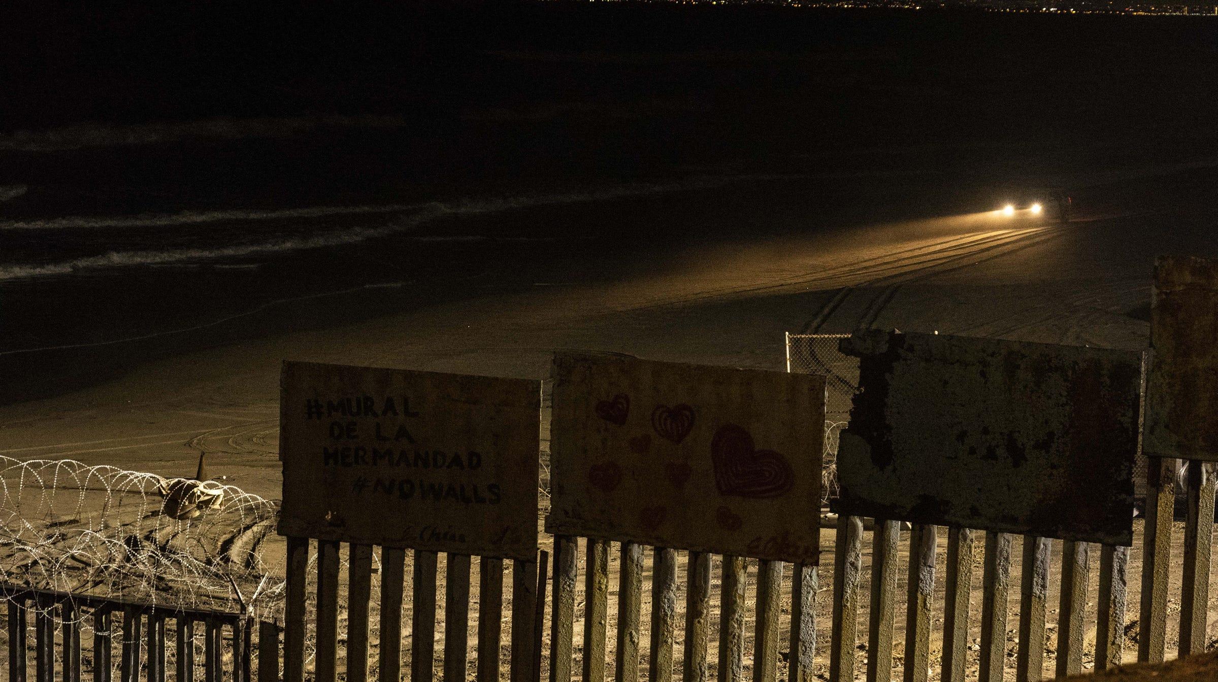 Border patrol headlights shine across Friendship Park, Tijuana, Mexico, February 2019.