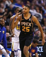 Phoenix Suns forward Mikal Bridges reacts after making a 3-pointer against the Golden State Warriors in the second half on Feb. 8 at Talking Stick Resort Arena.