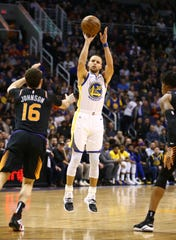 Golden State Warriors guard Stephen Curry shoots a jumper against the Phoenix Suns in the second half on Feb. 8 at Talking Stick Resort Arena.