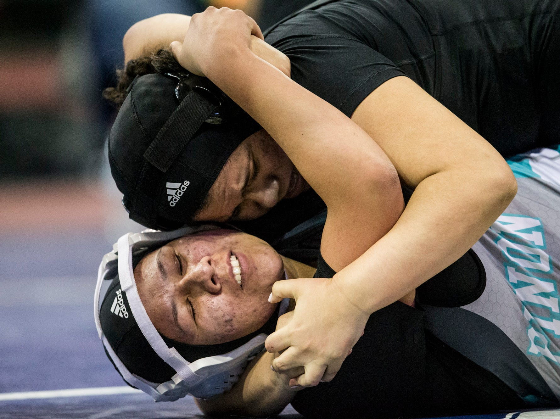Pinon's Destiny Magdaleno (bottom) and Cibola's Mariana Reyes wrestle during the girls wrestling championship on Friday, Feb. 8, 2019, at Prescott Valley Event Center in Prescott Valley, Ariz.
