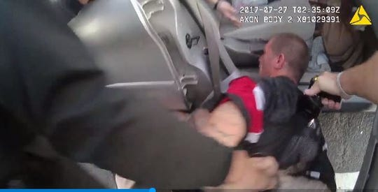 Glendale police use a Taser on  a suspect in an image from 2017 body-cam footage released by the Glendale Police Department.