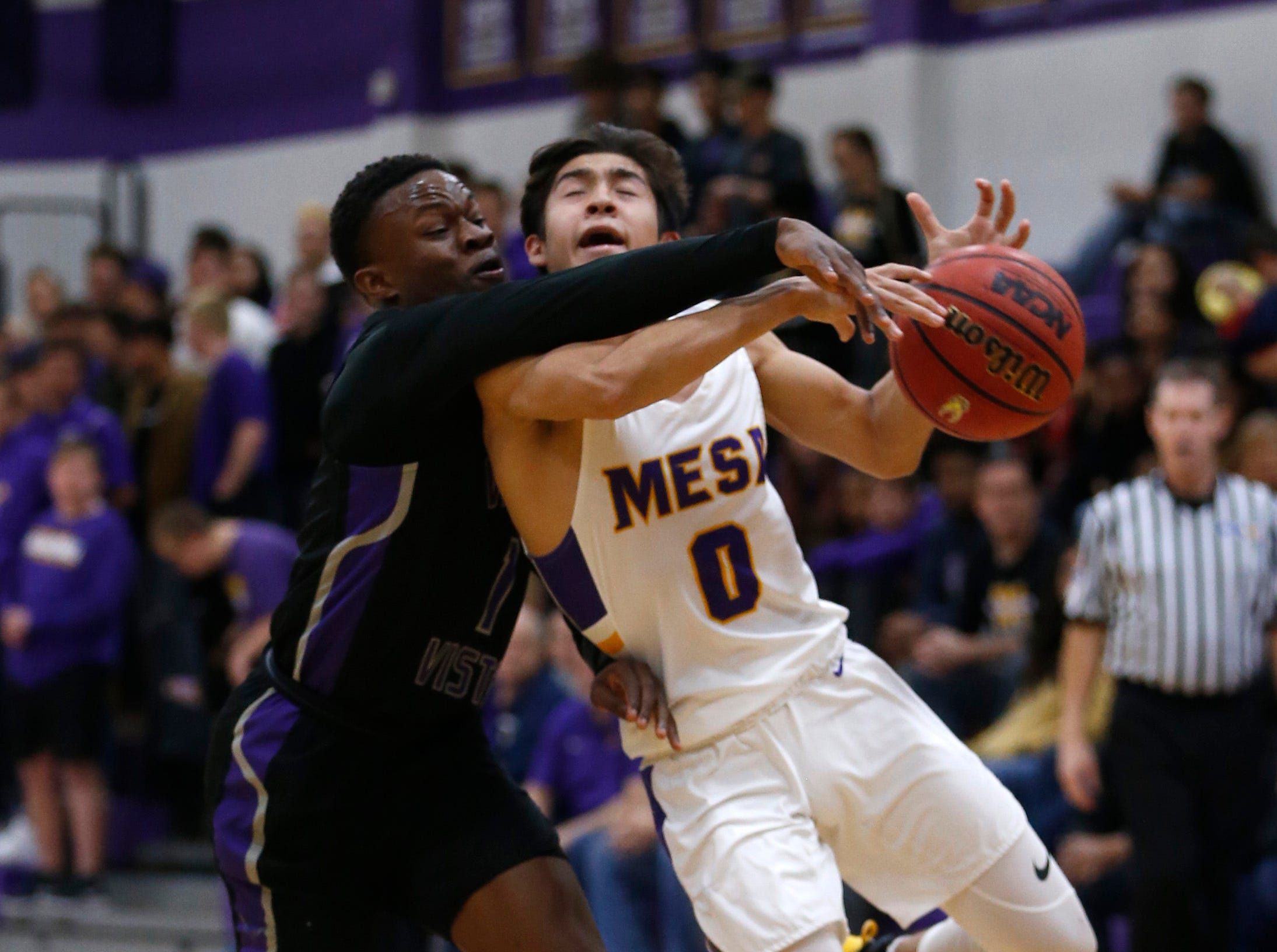 Valley Vista's Sidney Thomas (1) knocks the ball loose from Mesa's Tony Adame (0) during the first half of the boys basketball tournament play-in game at Mesa High School in Mesa, Ariz. on February 8, 2019.