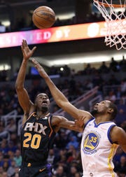 Phoenix Suns forward Josh Jackson (20) gets off a shot over Golden State Warriors forward Kevin Durant during the second half of an NBA basketball game Friday, Feb. 8, 2019, in Phoenix. The Warriors won 117-107. (AP Photo/Ross D. Franklin)