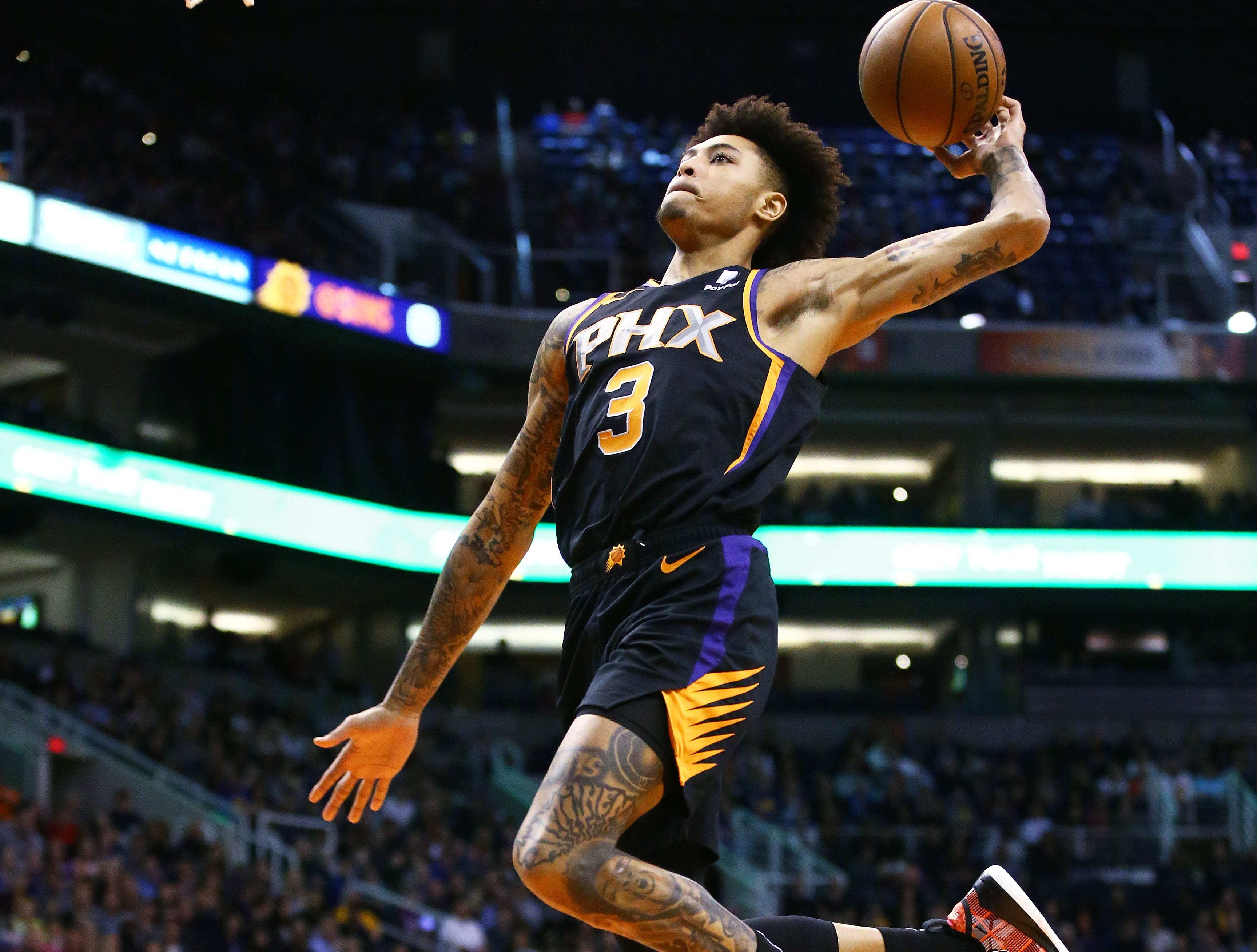 Phoenix Suns forward Kelly Oubre Jr. slam-dunks the ball against the Golden State Warriors in the first half on Feb. 8 at Talking Stick Resort Arena.