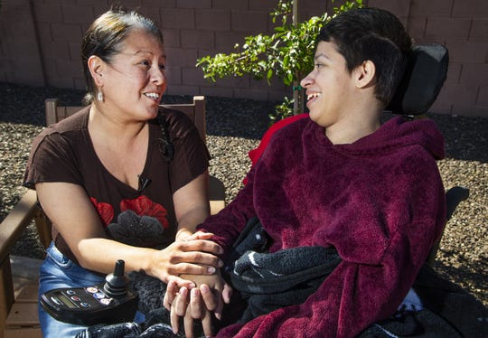 Karina Cesena and her daughter Jazzmyne Morris, 22, spend time outside their apartment in Phoenix on Feb. 8, 2019.