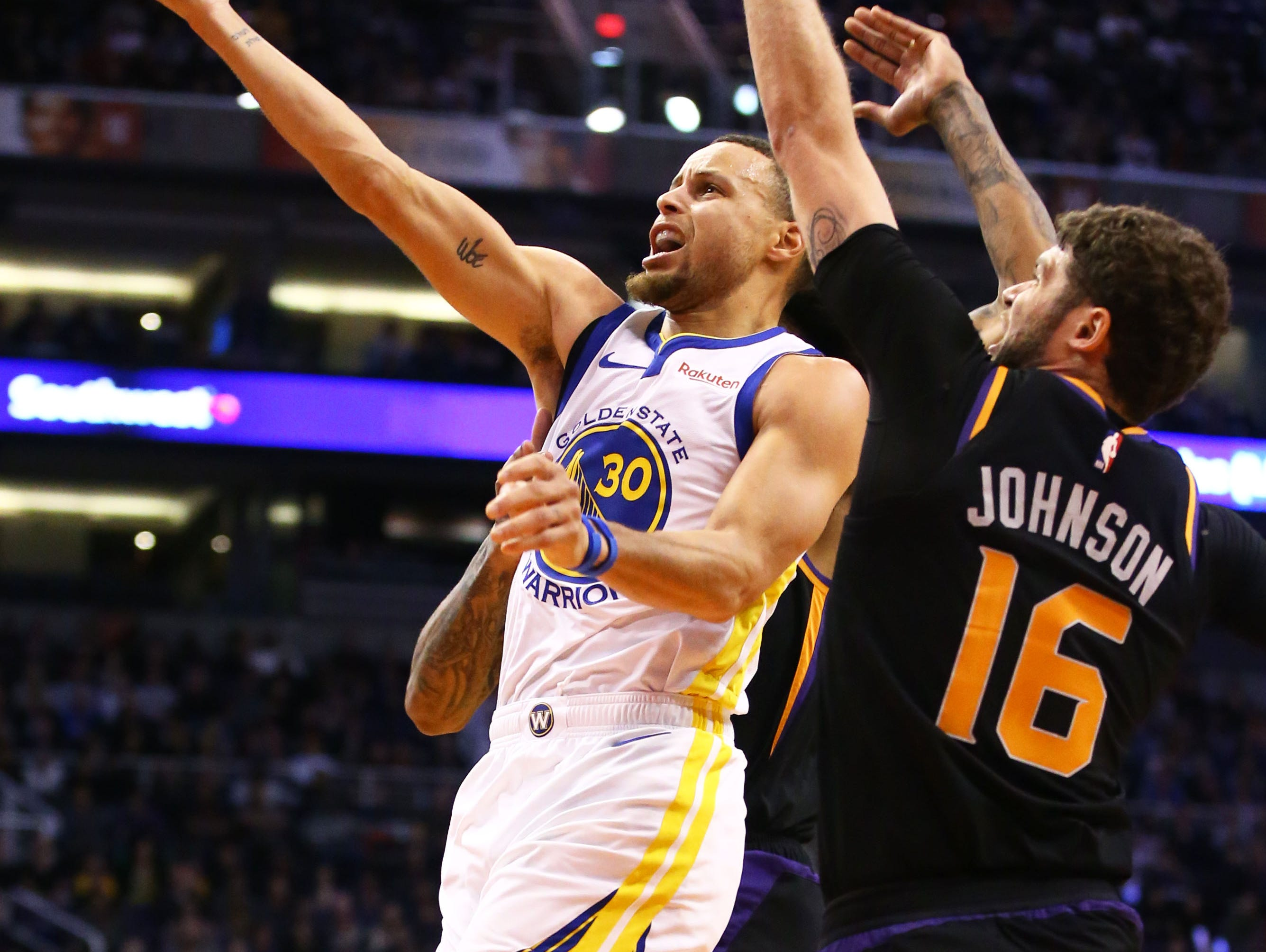 Golden State Warriors guard Stephen Curry drives to the basket against the Phoenix Suns in the second half on Feb. 8 at Talking Stick Resort Arena.