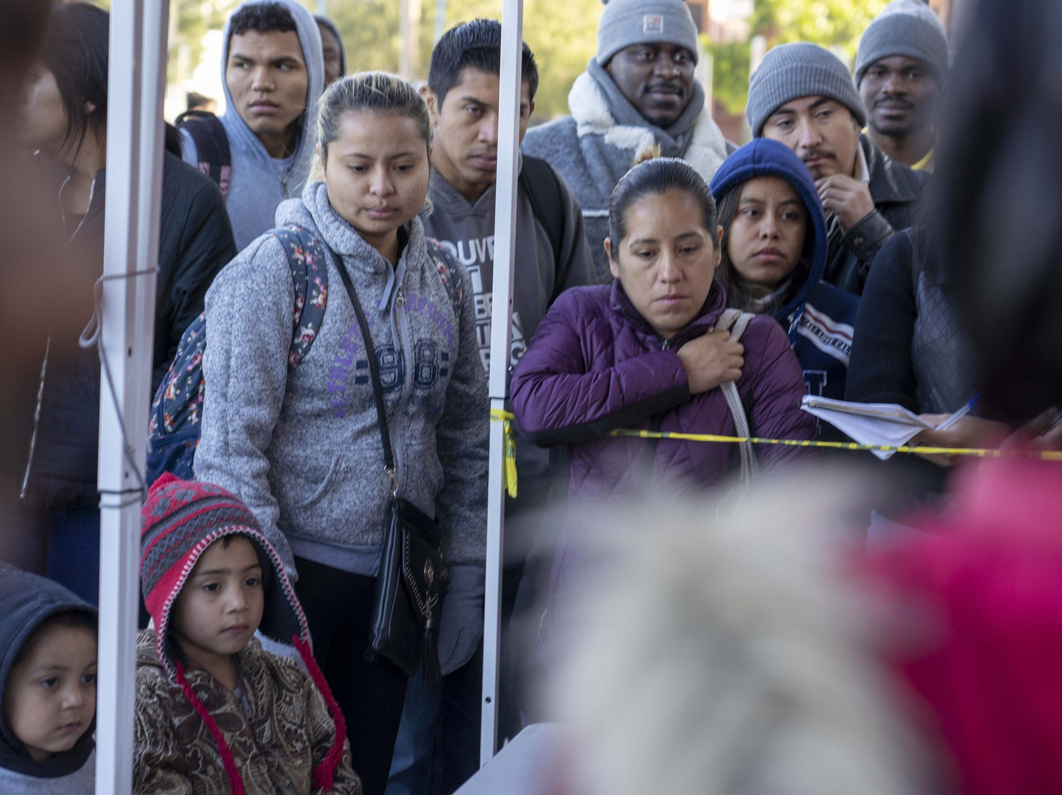 Asylum seekers from Central America and Mexico in line, February 2019, in Tijuana, Mexico, as they wait for their numbers to be called to meet with U.S. immigration officials.