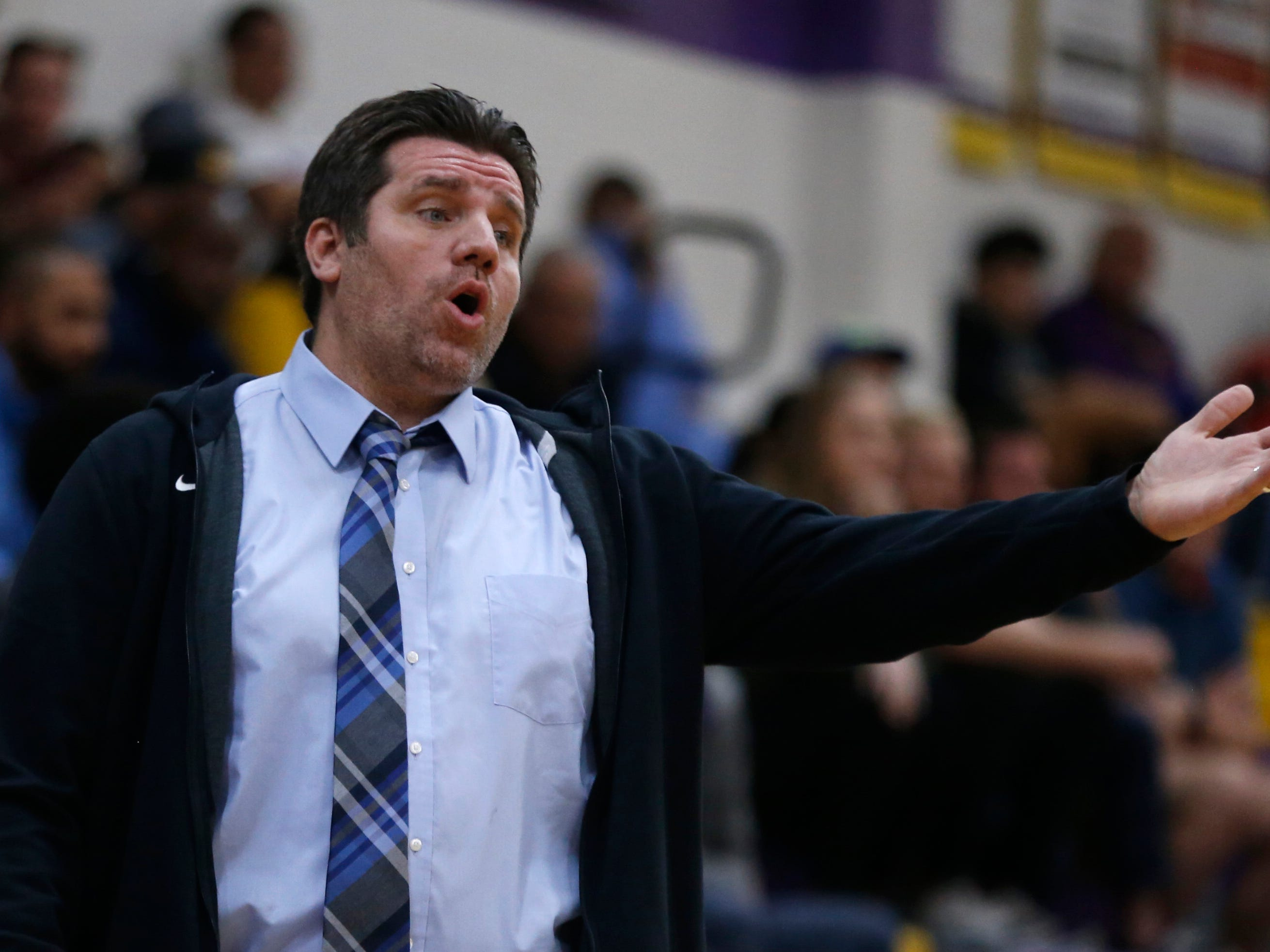 Valley Vista's head coach Ben Isai yells to his players during the first half of the boys basketball tournament play-in game against Mesa at Mesa High School in Mesa, Ariz. on February 8, 2019.
