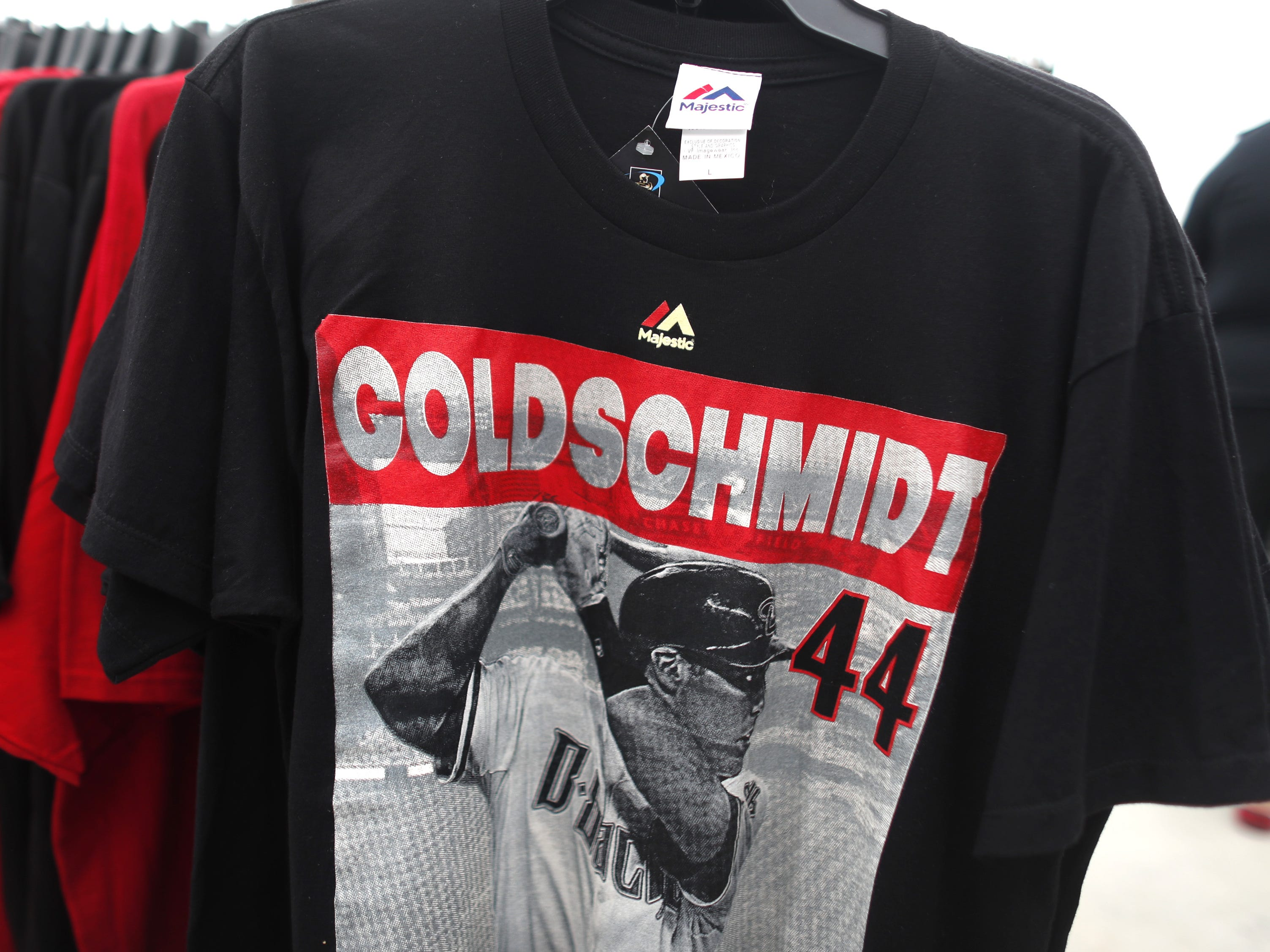 Shirts with the image of former Diamondbacks player Paul Goldschmidt on clearance during the Diamondbacks Fan Fest at Salt River at Talking Sticks on February 9, 2019.