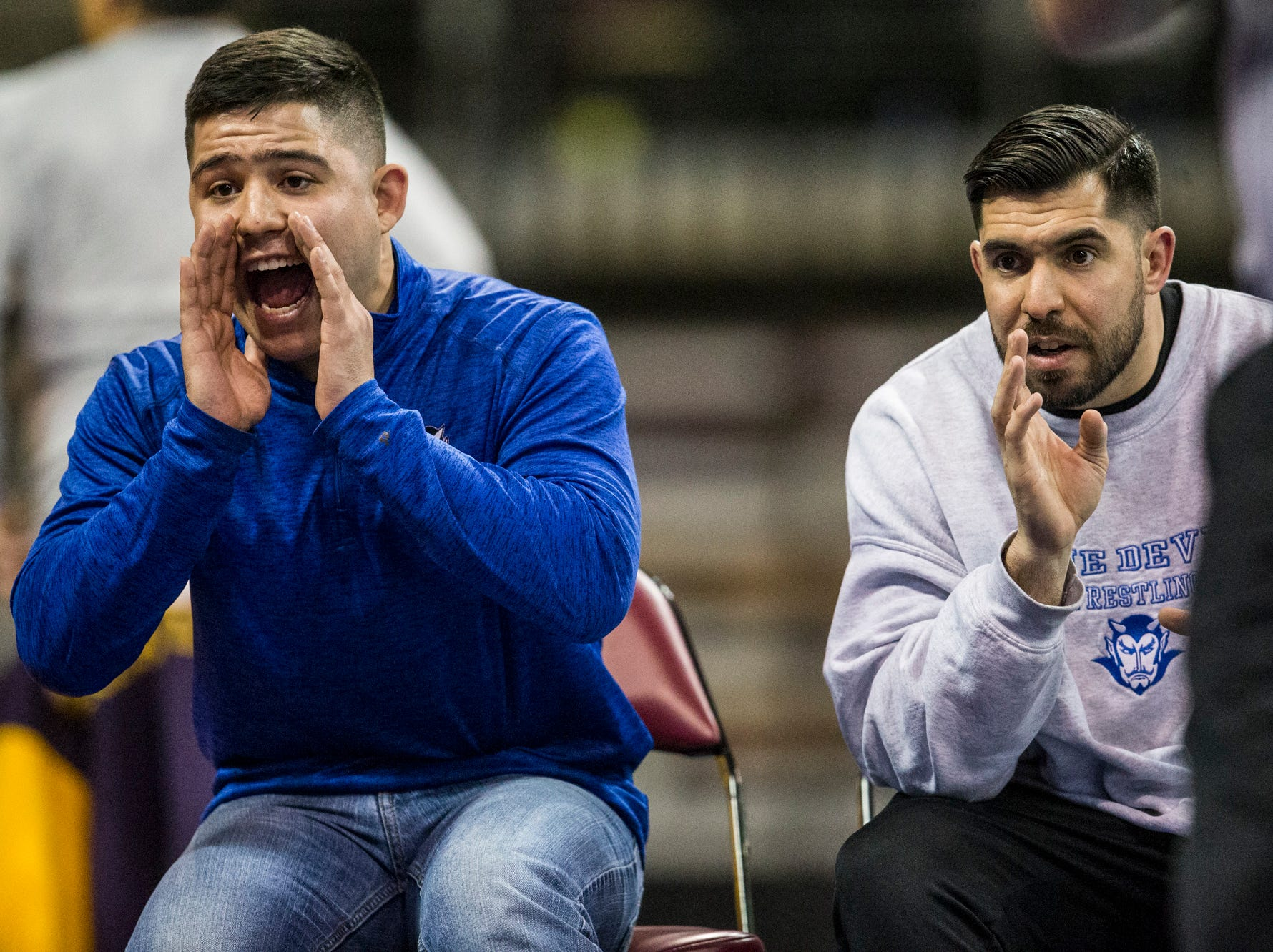 Sunnyside coach Juaquin Olivas (left) and head coach Anthony Leon yell as Rico Robles wrestles during the boys wrestling championship on Friday, Feb. 8, 2019, at Prescott Valley Event Center in Prescott Valley, Ariz.