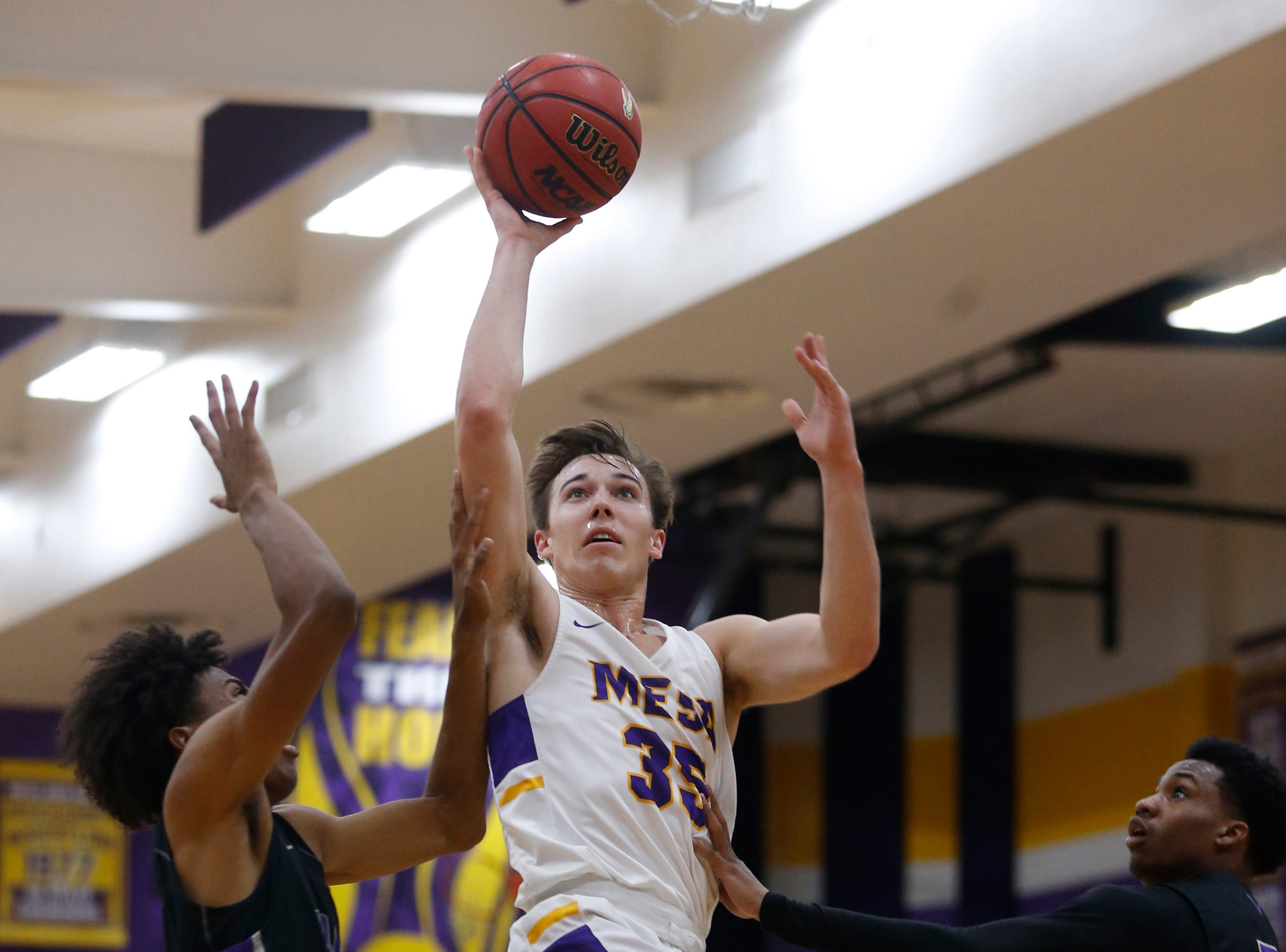 Mesa's Ammon Moritz (35) shoots against Valley Vista during the first half of the boys basketball tournament play-in game at Mesa High School in Mesa, Ariz. on February 8, 2019.