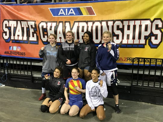 Feb. 8, 2019; Girls wrestling state championsh (L to R, top to bottom) Jessie McCurry of Deer Valley, Danni Schulz of Cottonwood Mingus, Jennifer Curry of Hamilton, Mia Didur of Centennial, Carolina Moreno of Kofa, Stefana Jelacic of Chandler, and Sierra Thrun pose with their title medals.